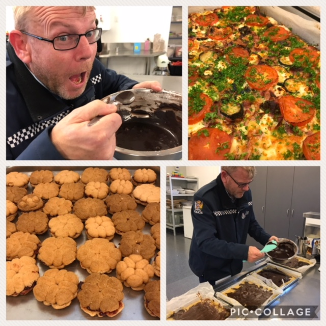Constable Aaron Smith taste tests the chocolate icing and adds the final touches to the camramel slice.