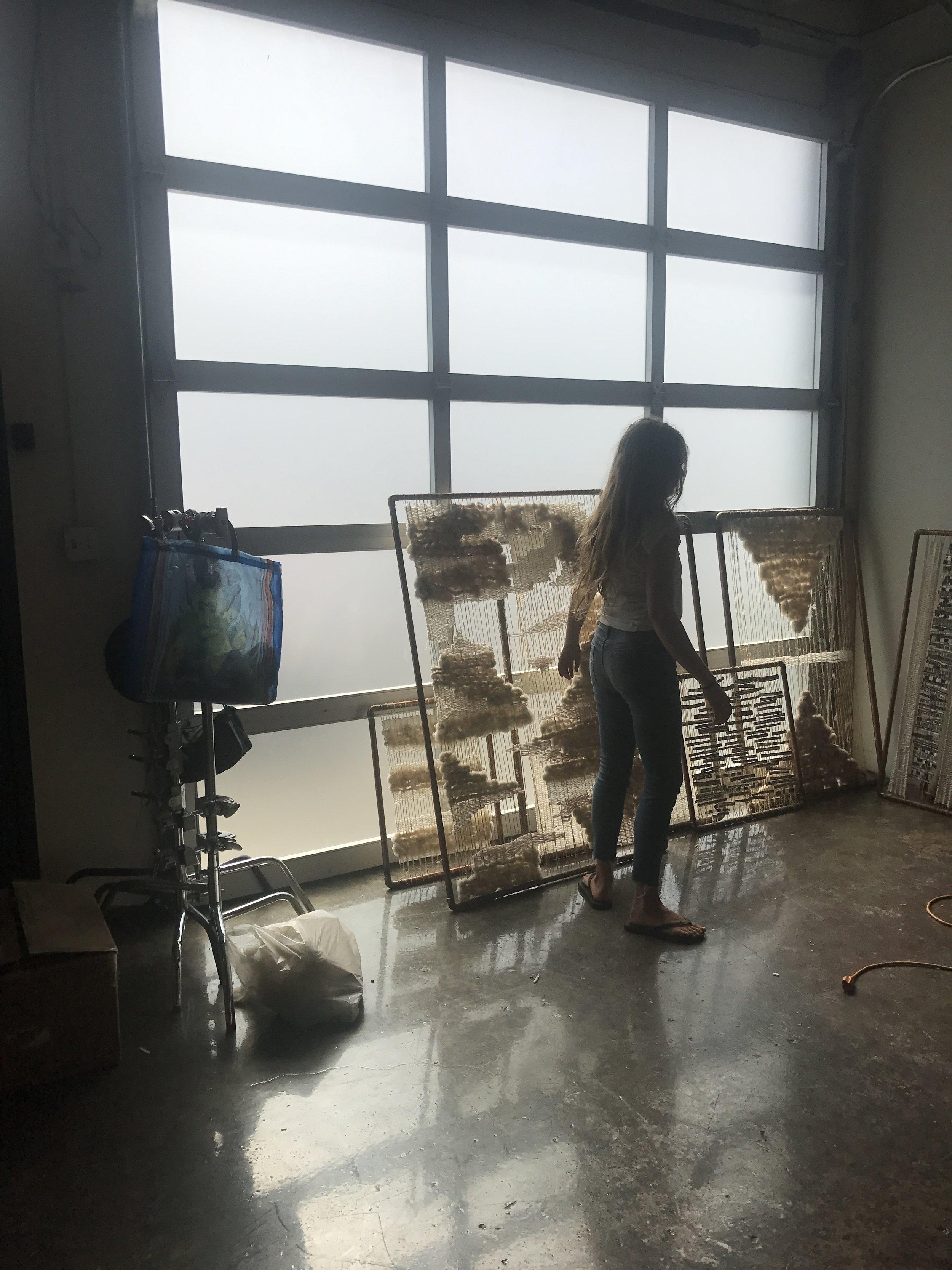 Filming inside the artist's studio.
