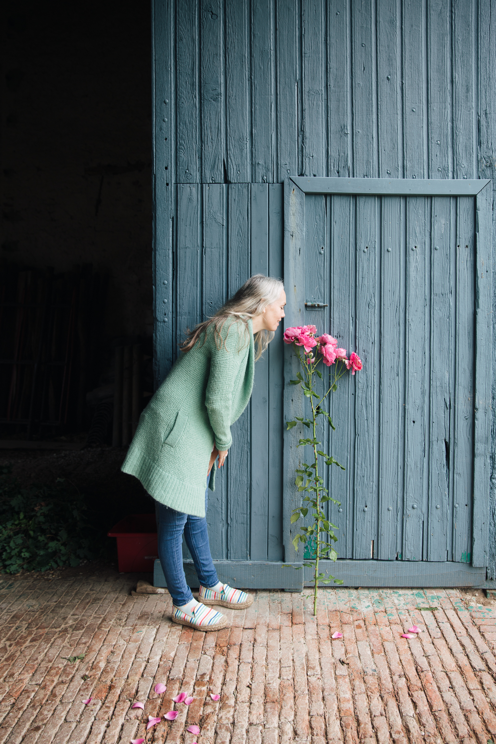 Xanthe admiring the super long-stemmed roses we were able to cut from the garden