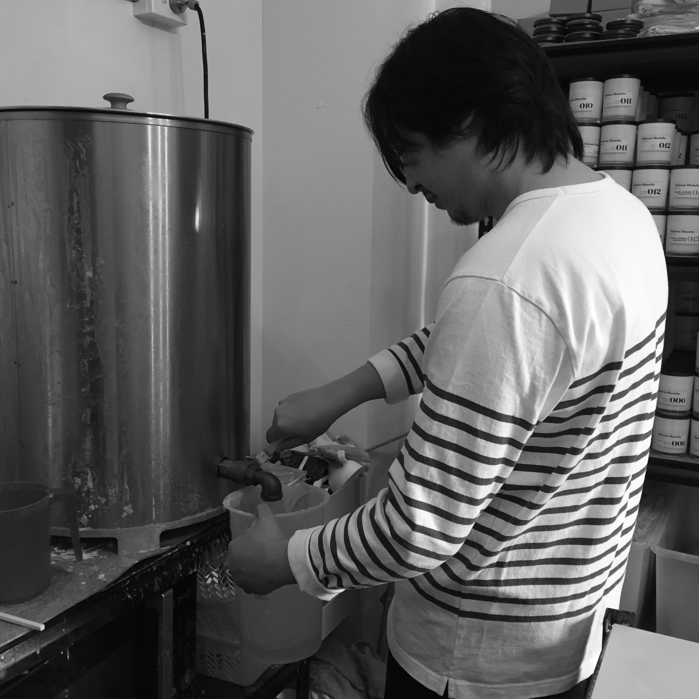 Mixing our fragrance with the melted soy wax.