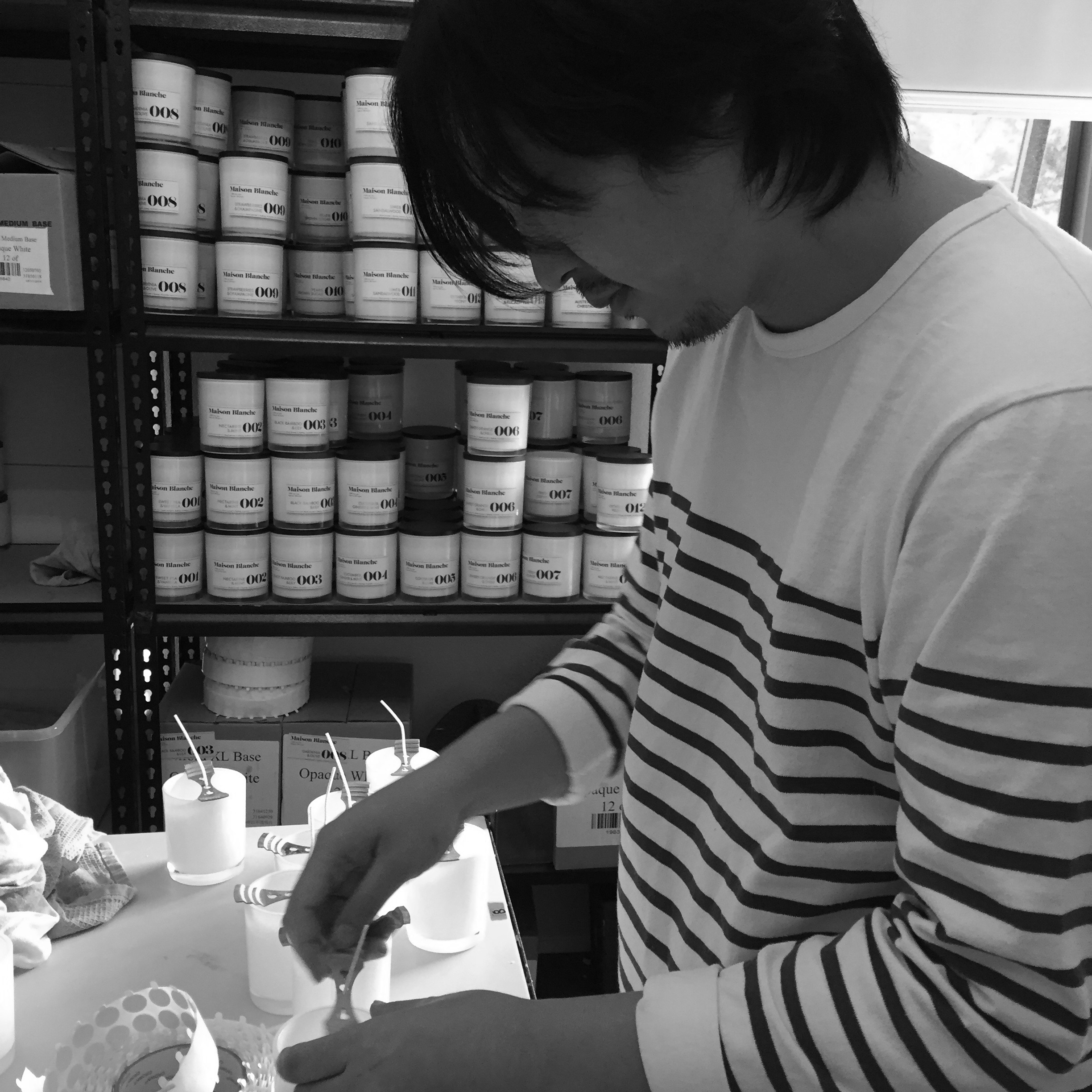 Nathan Lee, putting a whole lot of love into the production of these hand-poured candles.
