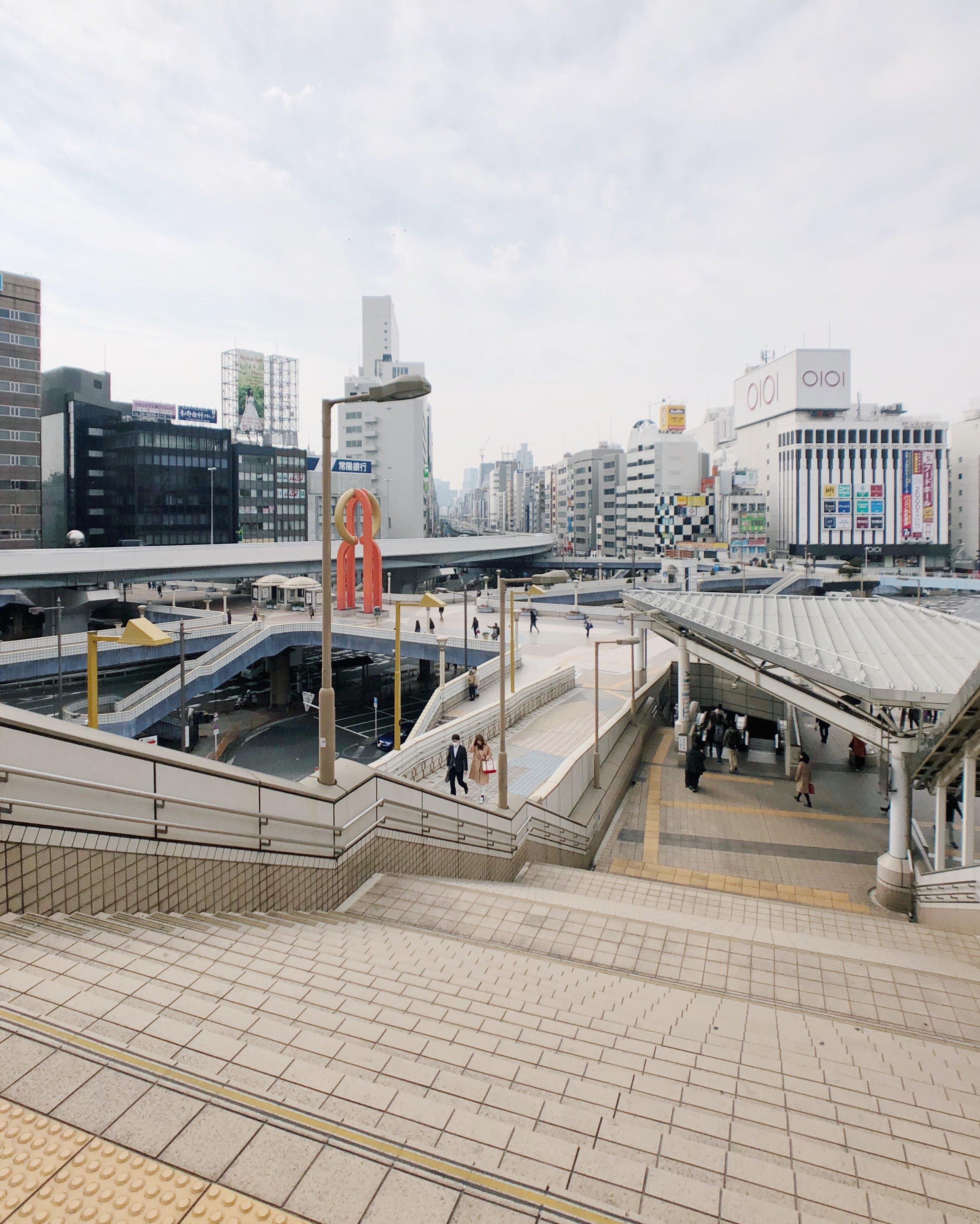 Underpass, overpass, cars, pedestrians.