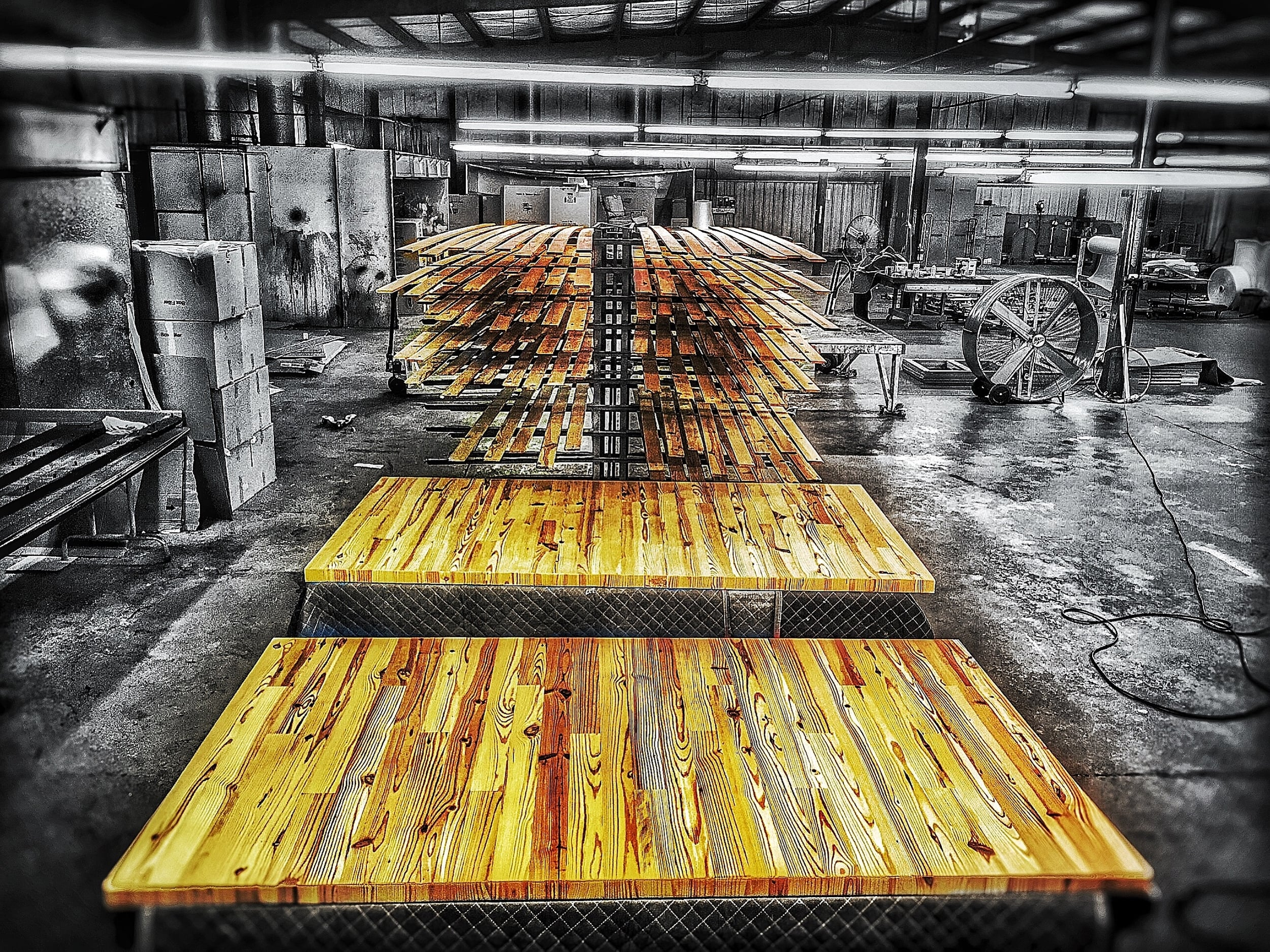 Reclaimed Knotty Pine flooring gets refinished for a new life as Industrial Doors and Walls