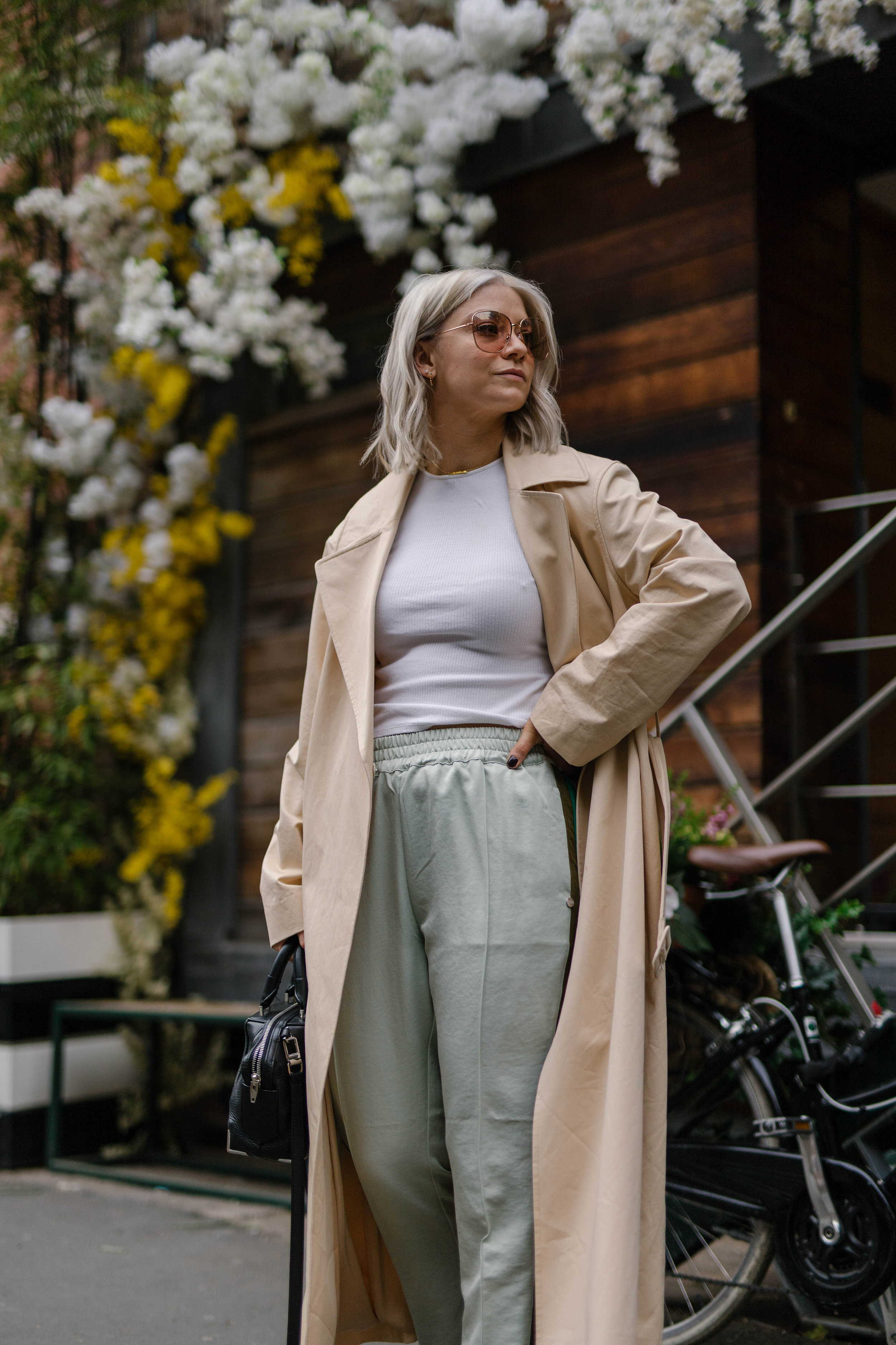sporty spice outfit, with scotch and soda trousers, & other stories trench coat outside a florist in the northern quarter manchester, with blonde bob hair cut, joey taylor, northern magpie 2