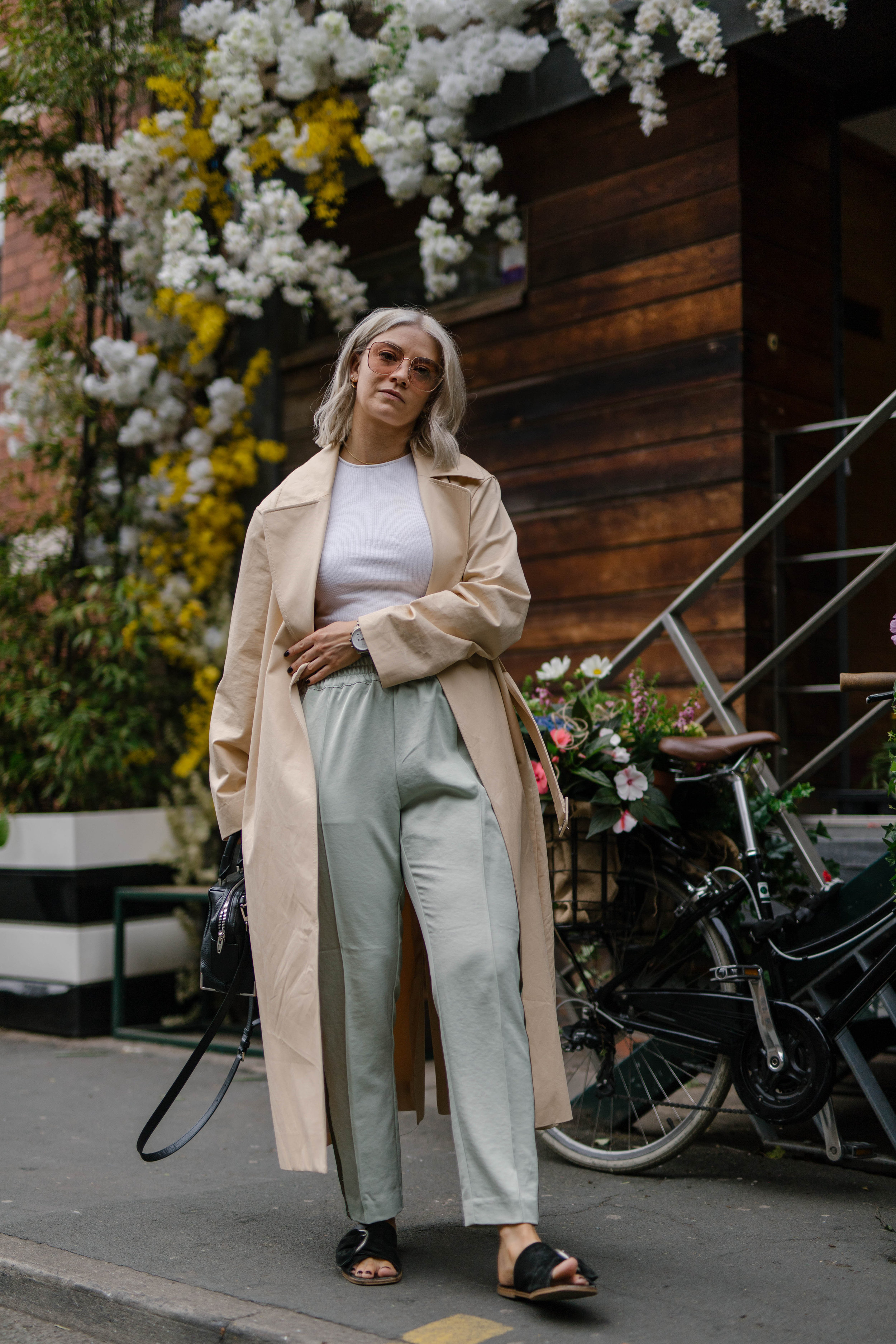 sporty spice outfit, with scotch and soda trousers, & other stories trench coat outside a florist in the northern quarter manchester, with blonde bob hair cut, joey taylor, northern magpie 3