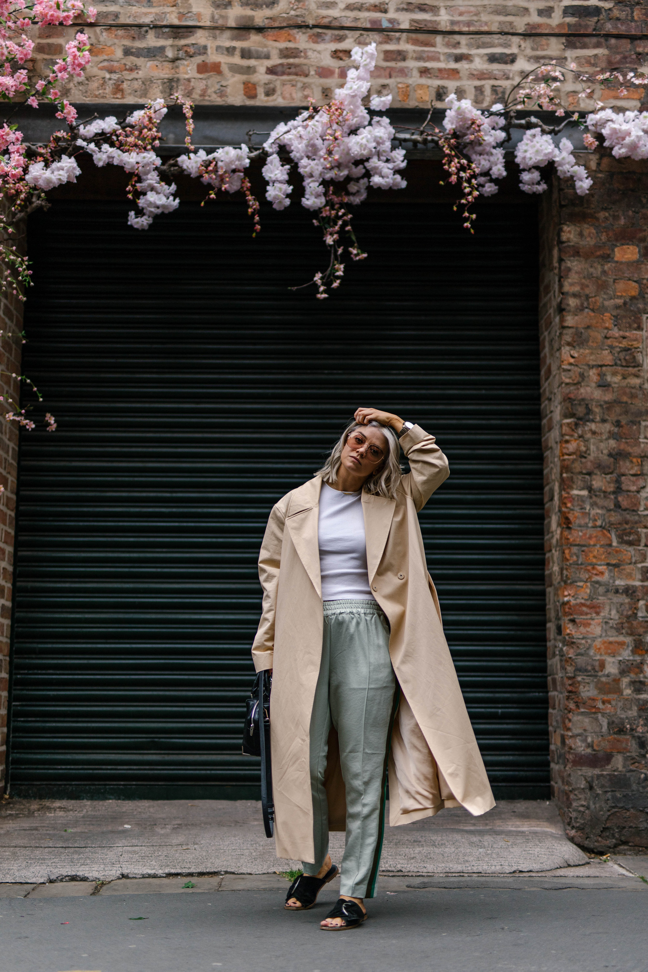 sporty spice outfit, with scotch and soda trousers, & other stories trench coat outside a florist in the northern quarter manchester, with blonde bob hair cut, joey taylor, northern magpie 4
