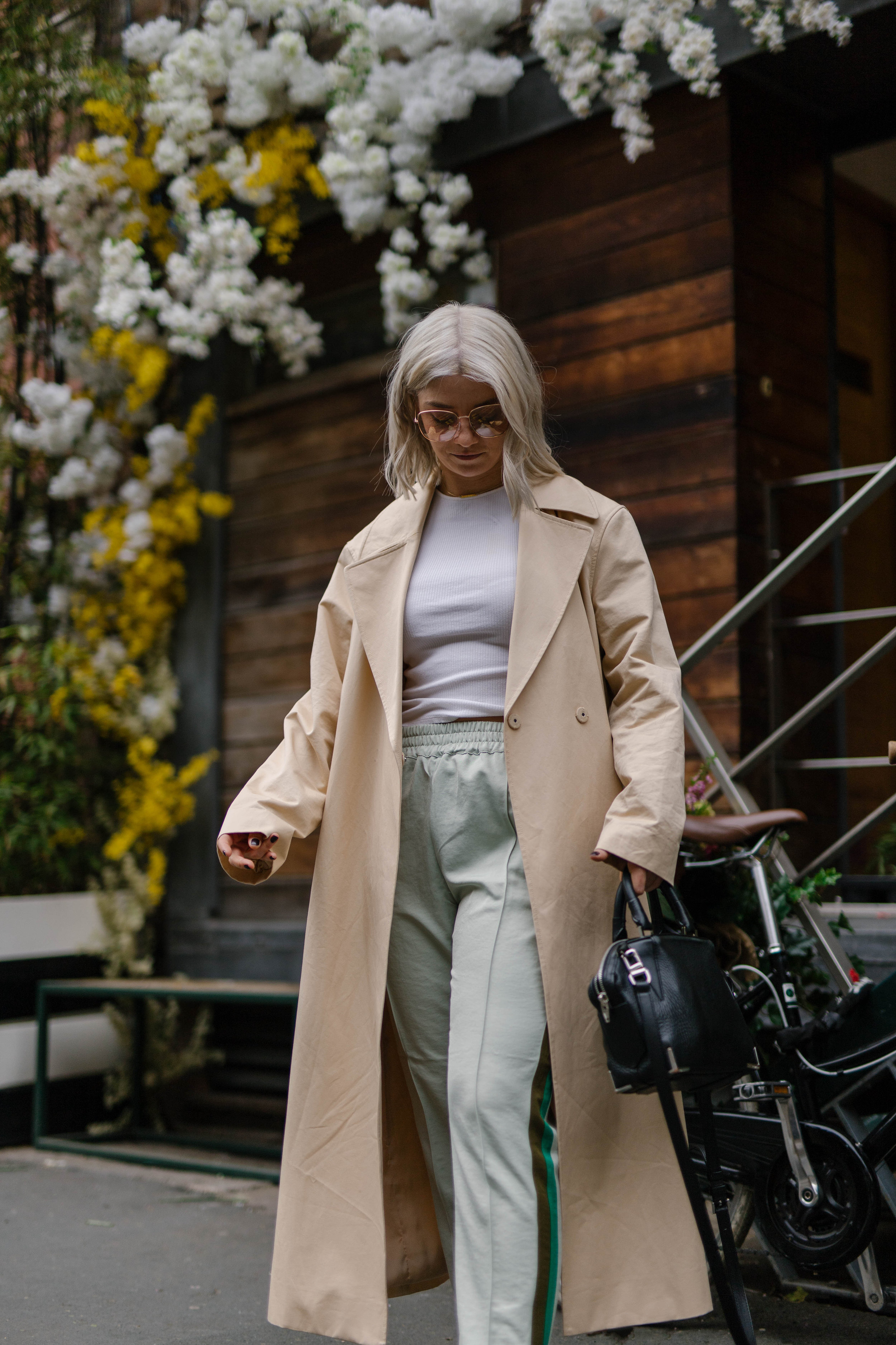 sporty spice outfit, with scotch and soda trousers, & other stories trench coat outside a florist in the northern quarter manchester, with blonde bob hair cut, joey taylor, northern magpie 6