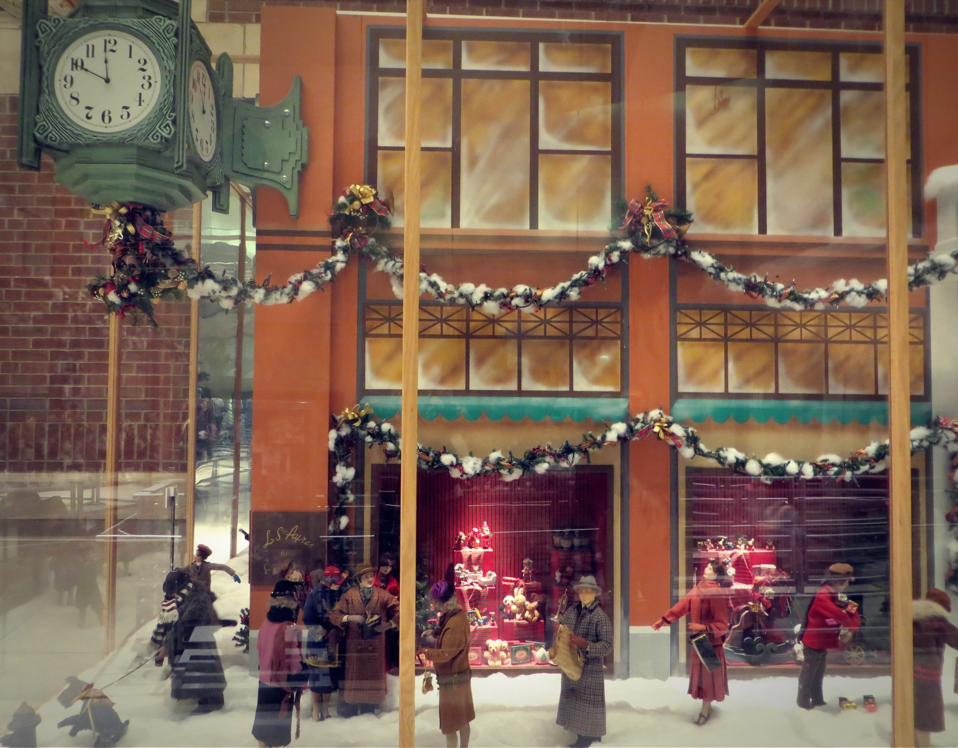 Animated window display celebrates L. S. Ayres & Co. traditions.