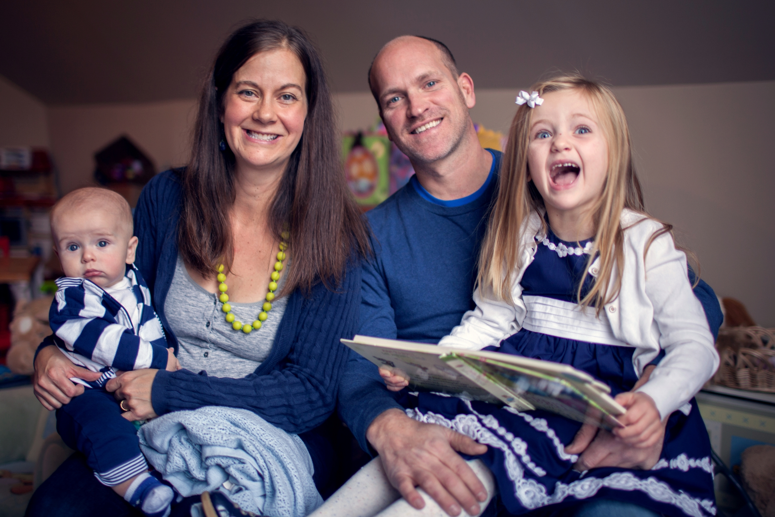 New to the neighborhood: Pete and Mary Kuhns with their two children.   Photo credit: Ann Pumphrey Photography.