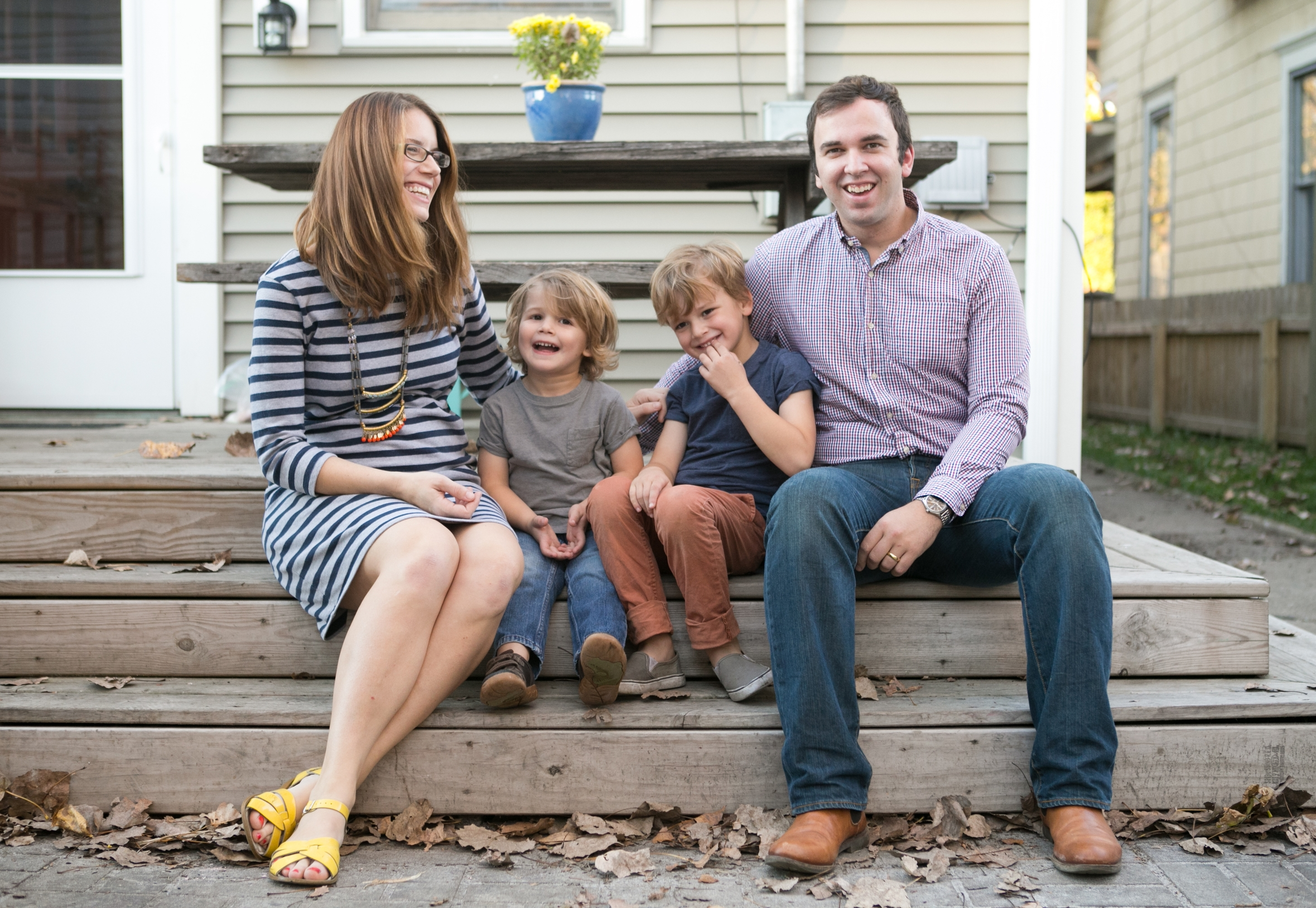 Adrian & Ann Pumphrey sit on the back steps of their home in historic Fountain Square with their two sons, aged 5 and 3. [photo credit: Melissa Williams]