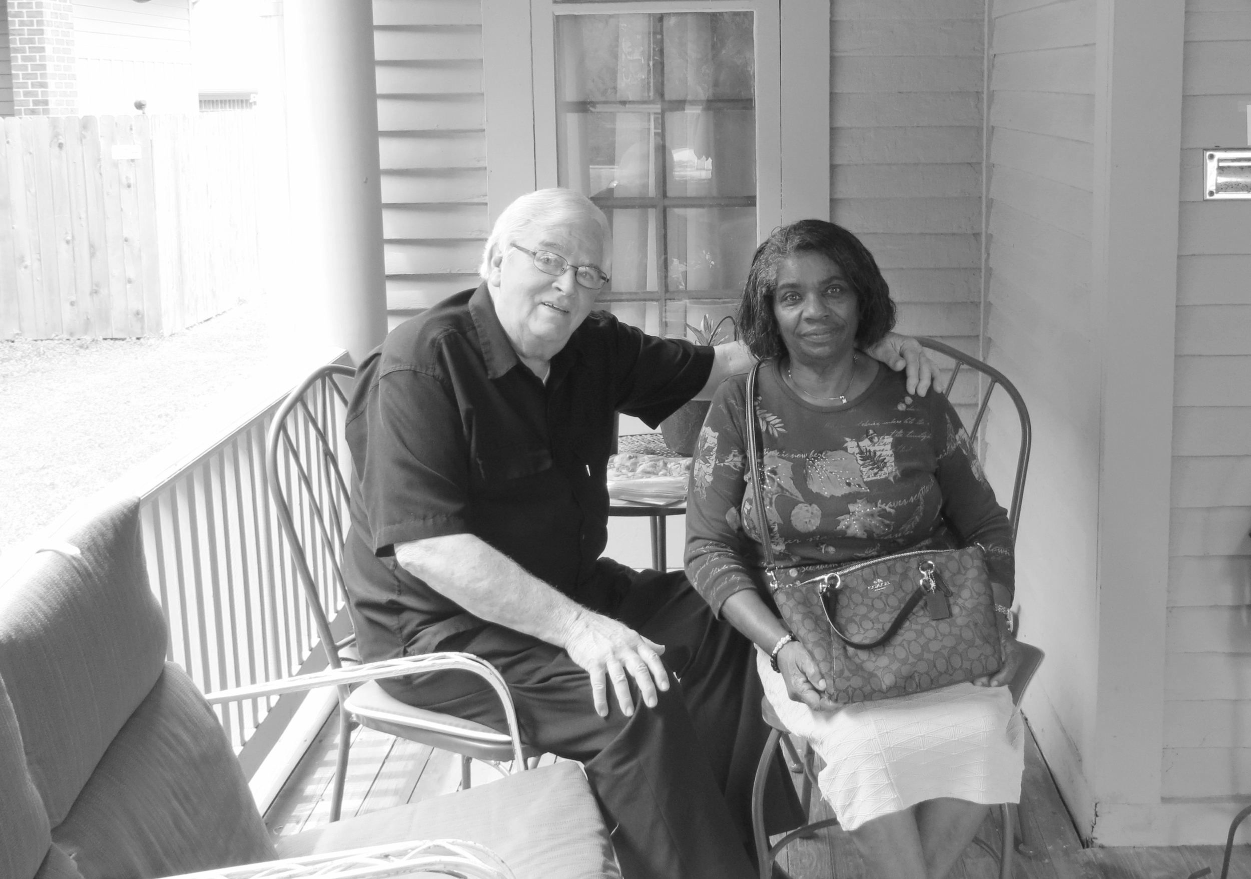 Lloyd & Lena Sprowl on the front porch of their historic Old Northside home.