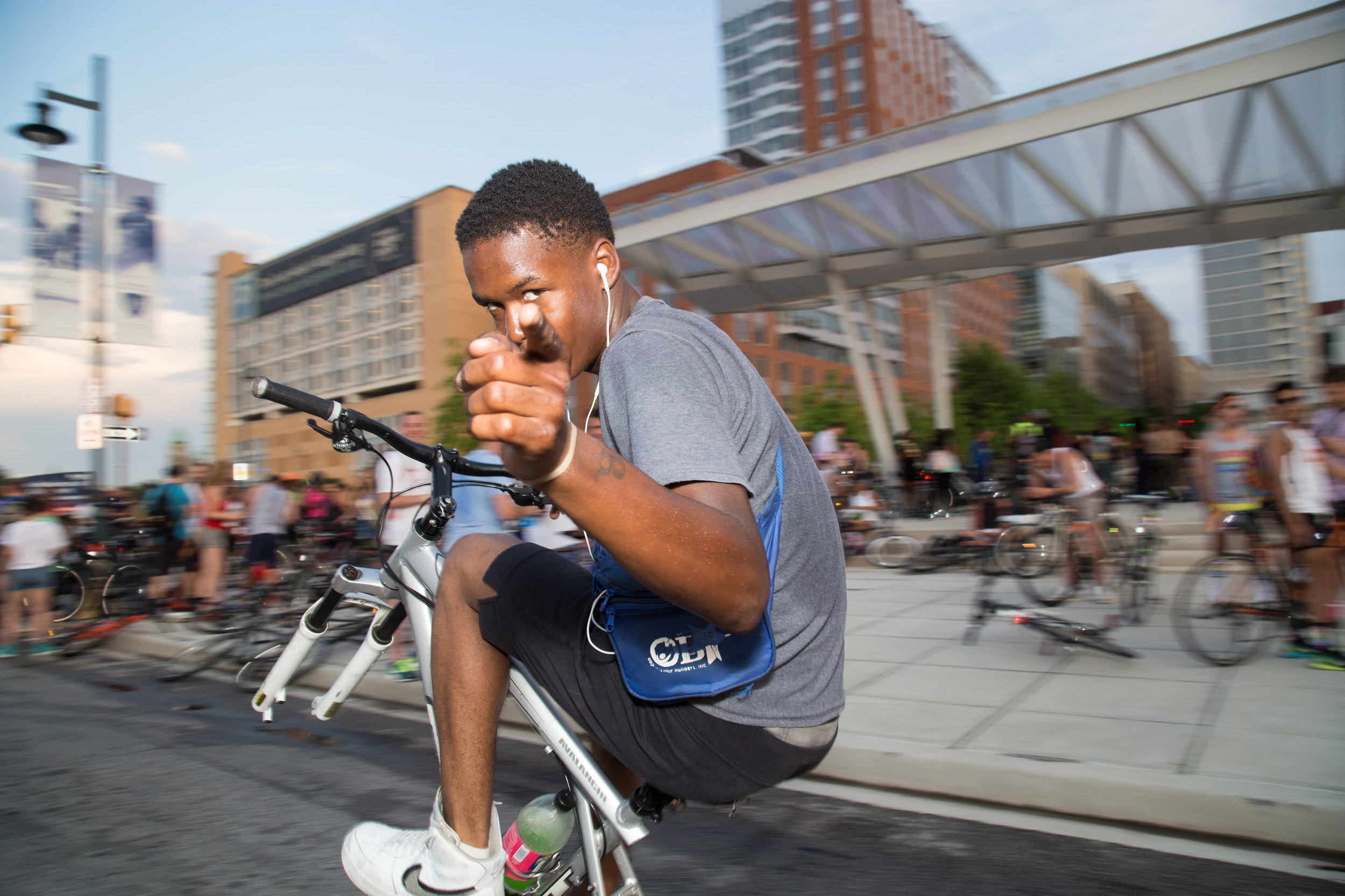 Biker Boy Dez  photographed by E. Brady Robinson, 2019.  Bike Party! Yelling the words is a call to action, a signal that it's the last Friday of the month and time to meet friends and celebrate life in Baltimore on a bike. For more visit  Baltimore Bike Party: Pride Ride Photo Essay in Bmoreart .  Baltimore Bike Party  = best night of the month!