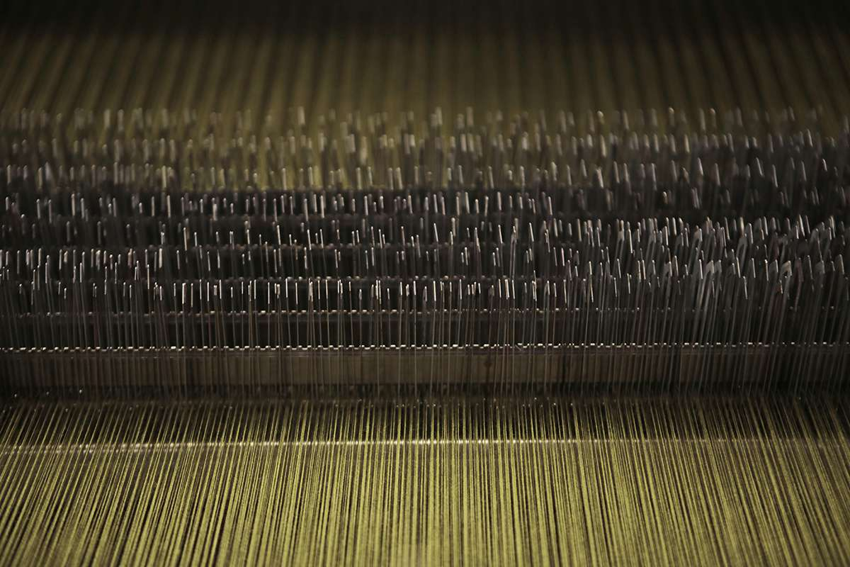 Weaving process at Bute Fabrics. Image courtesy of  Make  Works .
