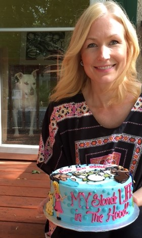Here I am with the cake (and Lala, photobombing.)