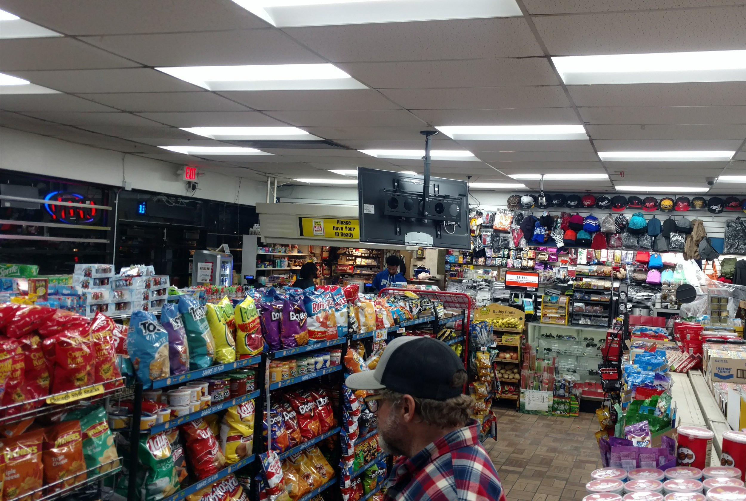 Our convenience store. (That's Husband in the foreground eyeballing the chips.)
