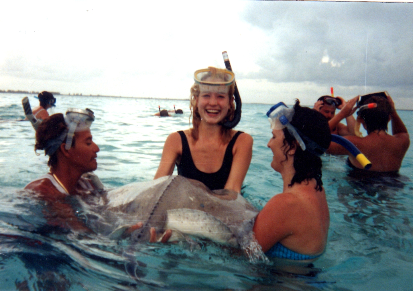 Holding a stingray. (On the left is one of our tour guides.)