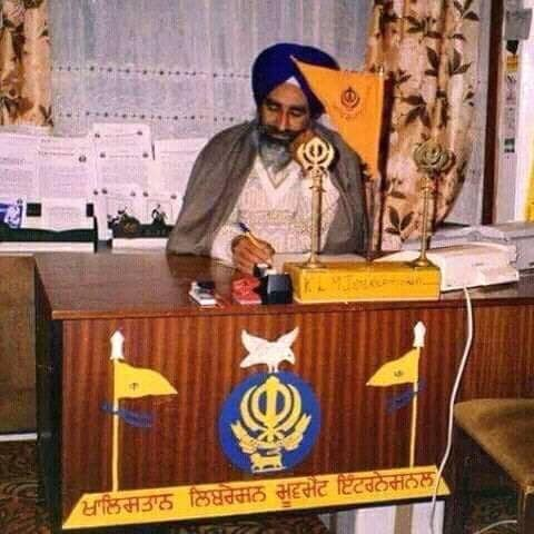 Shaheed Bhai Jaswant Singh Khalra at the desk of the Khalistan Liberation Movement International, an organisation he founded to work for Sikh justice.
