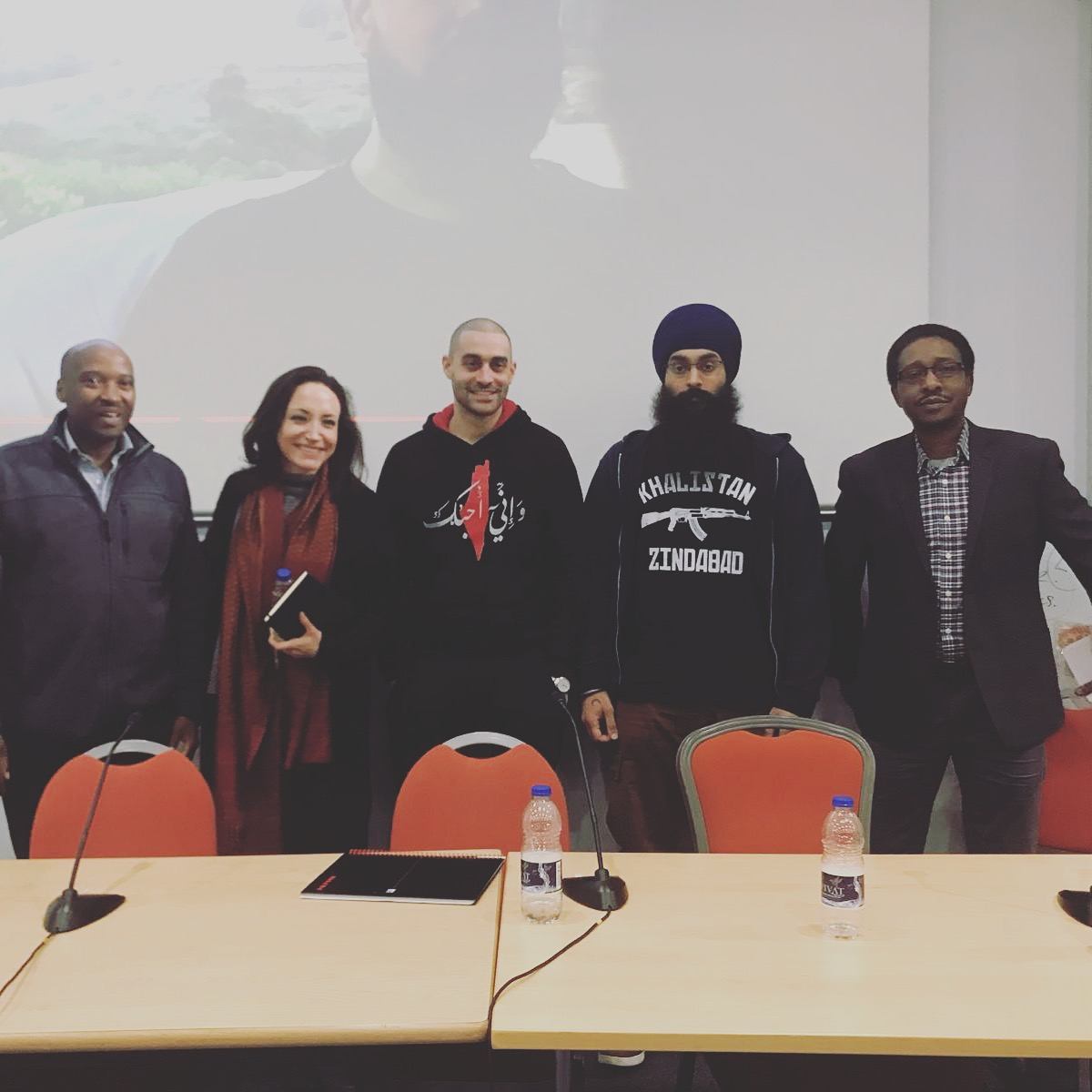 from left to right:  Julius Mbaluto  - Founder and editor of Informer East Africa (UK-based diaspora newspaper) who covered the Mau Mau case in London.  Olivia Windham Stewart  - Founder of The Museum of British Colonialism.  Lowkey  - Rapper and activist.  Shamsher Singh  - co-founder of nsyf, sikh activist and ally of dom.  Dr Chege Githiora  -senior Lecturer in Swahili at SOAS and Gikuyu translator during the Mau Mau case in London.