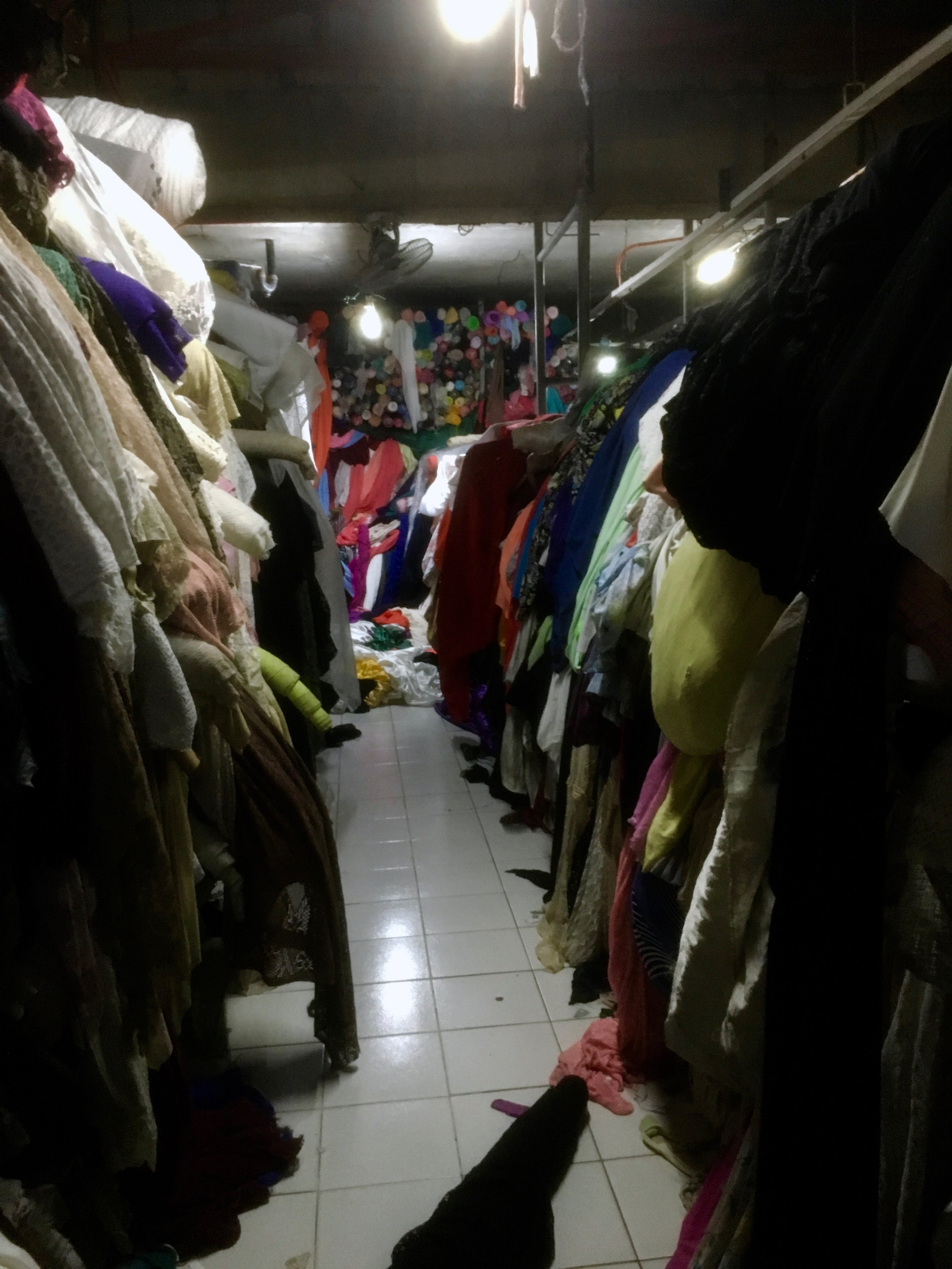 A typical scene in a fabric warehouse where excess/waste fabric is sold by the kilo.