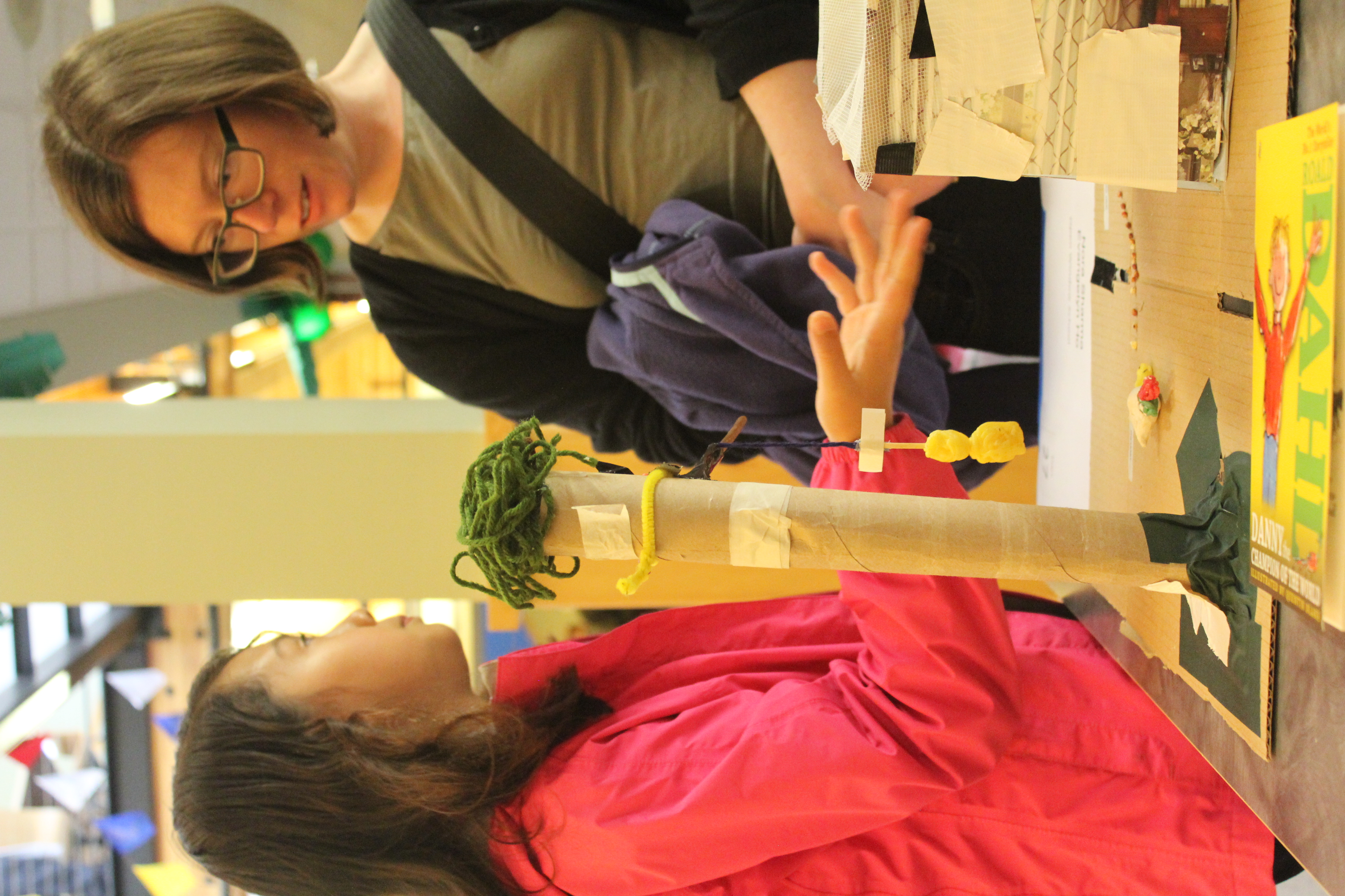One participating student explains her team's Pheasant Trap to an attendee.