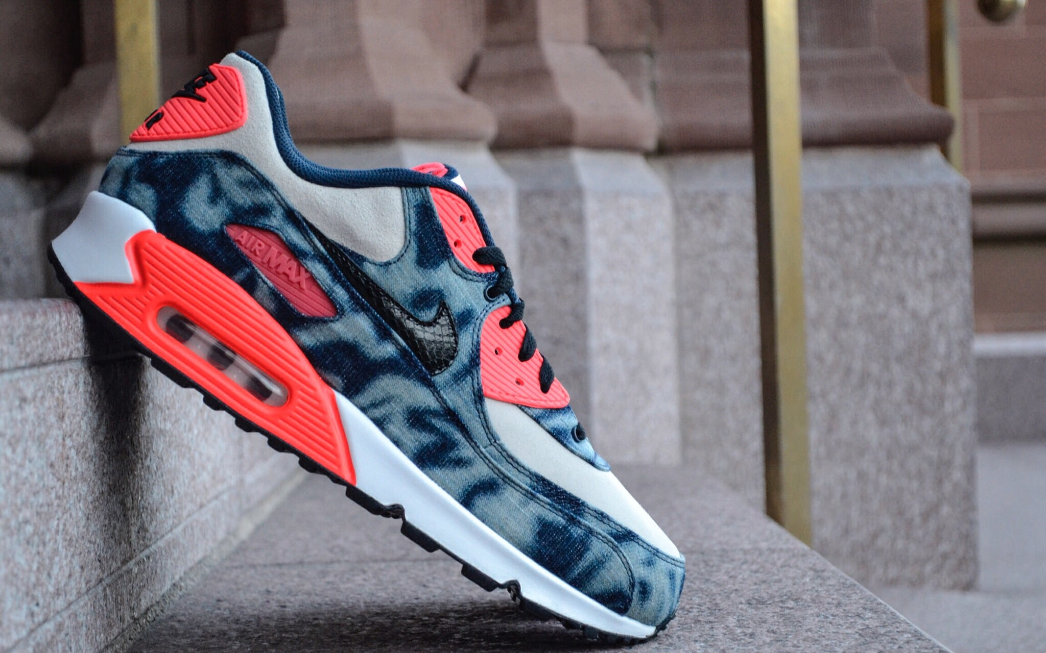 """The Nike Sportwear Air Max 90 QS """"Bleached Camo"""" utilizes a premium suede and denim upper along with hits of the classic Nike Infrared hue."""