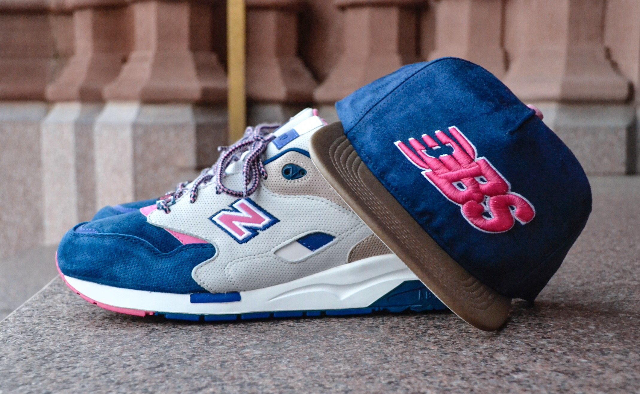 """The DBS """"Daytona"""" snapbackuses a mixture of Navy Suede andTan vinyl, along with pink and off-white accents to bring the """"Daytona"""" theme to life."""