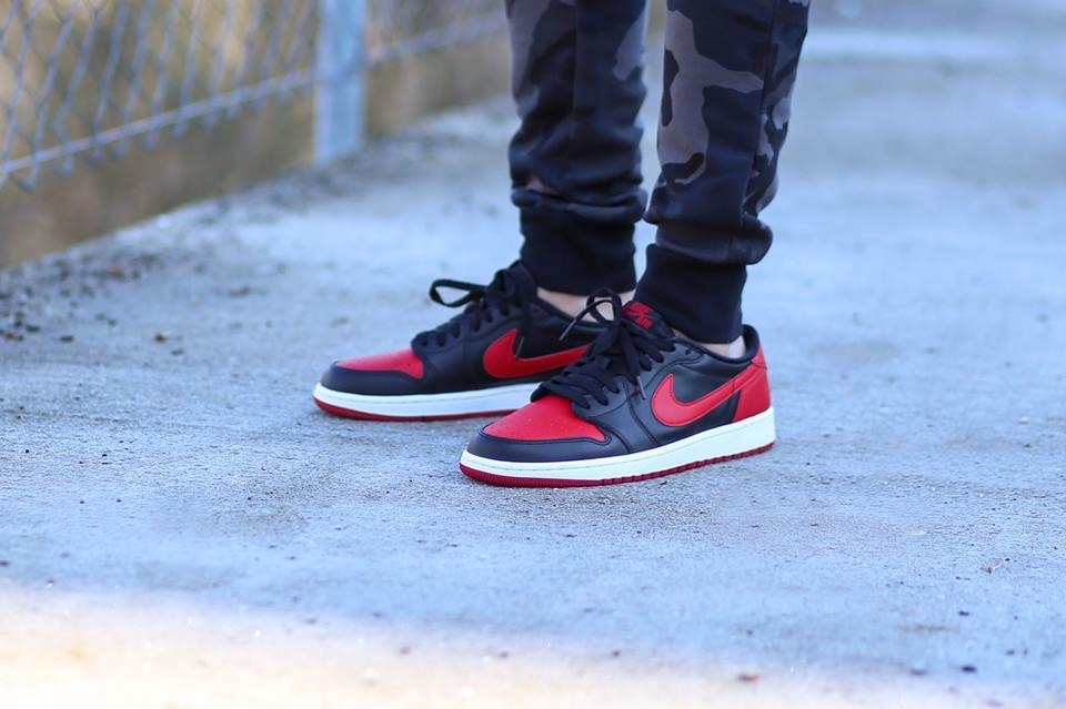 "An on-foot look at the Air Jordan 1 OG Low Black/Red ""Bred"" colorway that dropped back on Valentines at select Jordan Brand retailers."