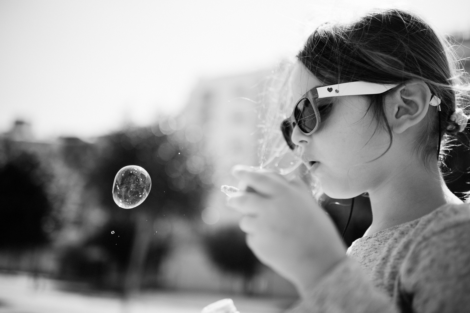 2. Sofía loves playing with bubbles and it's become kind of a challenge to come up with different photographs after some time. I find this b&w very special.