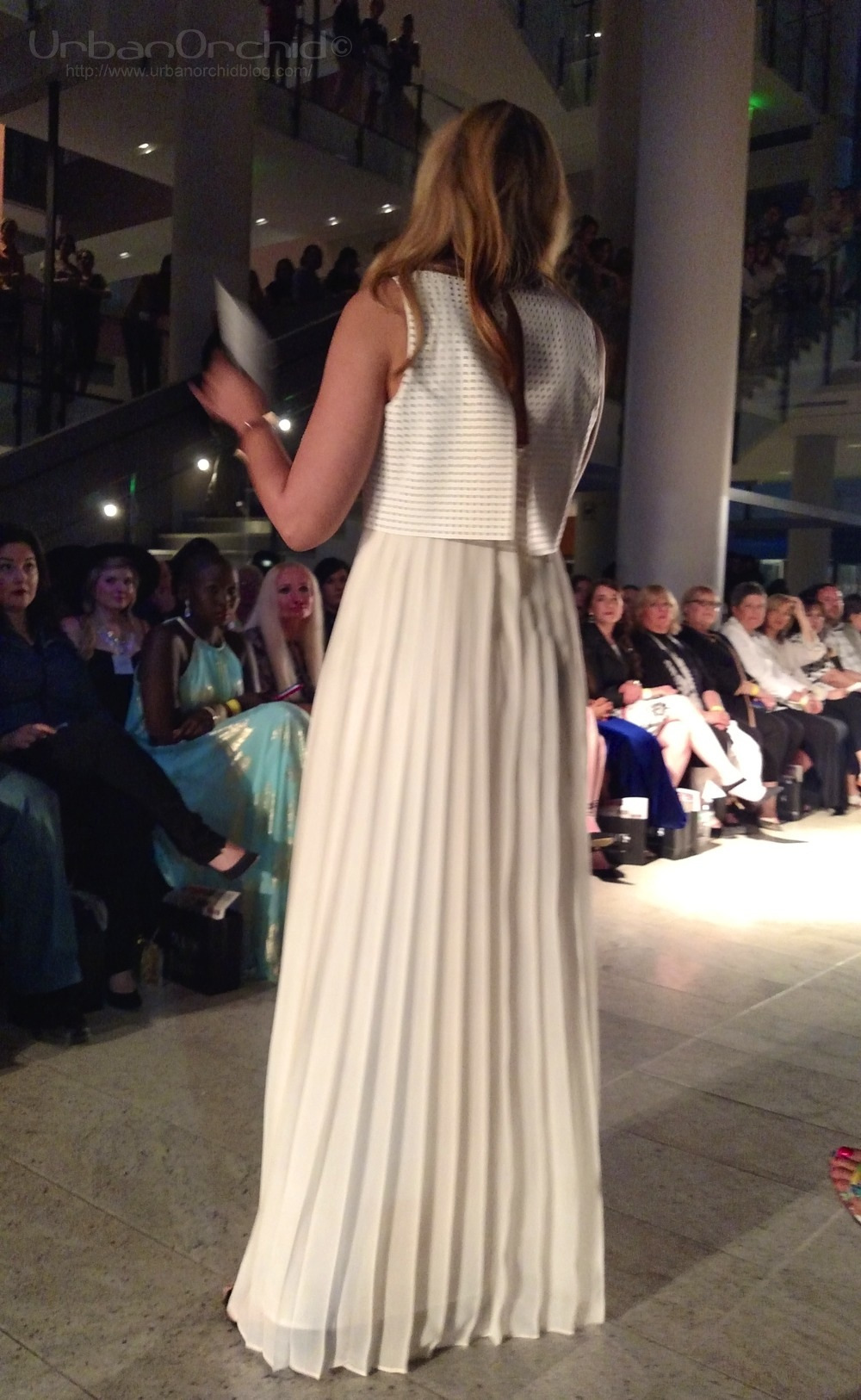 Trisha in a white maxi dress hosting Envision.