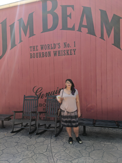 Sippin' on a Bourbon Sour with fresh basil and lemon in front of the Jim Beam Bourbon Bar in Clermont, KY.