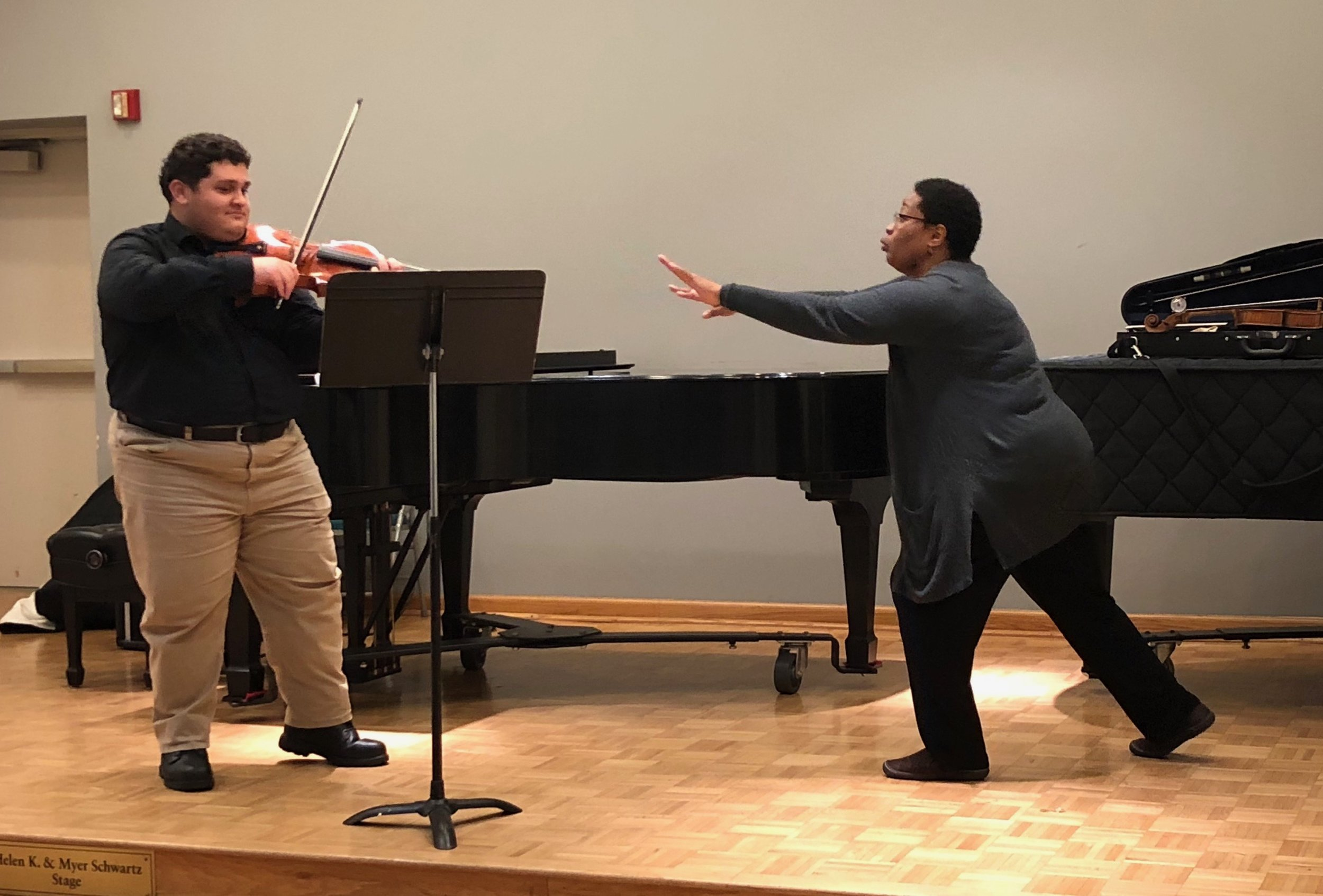 Aundrey Mitchell coaching Adam Brotnitsky during a Sterling Masterclass