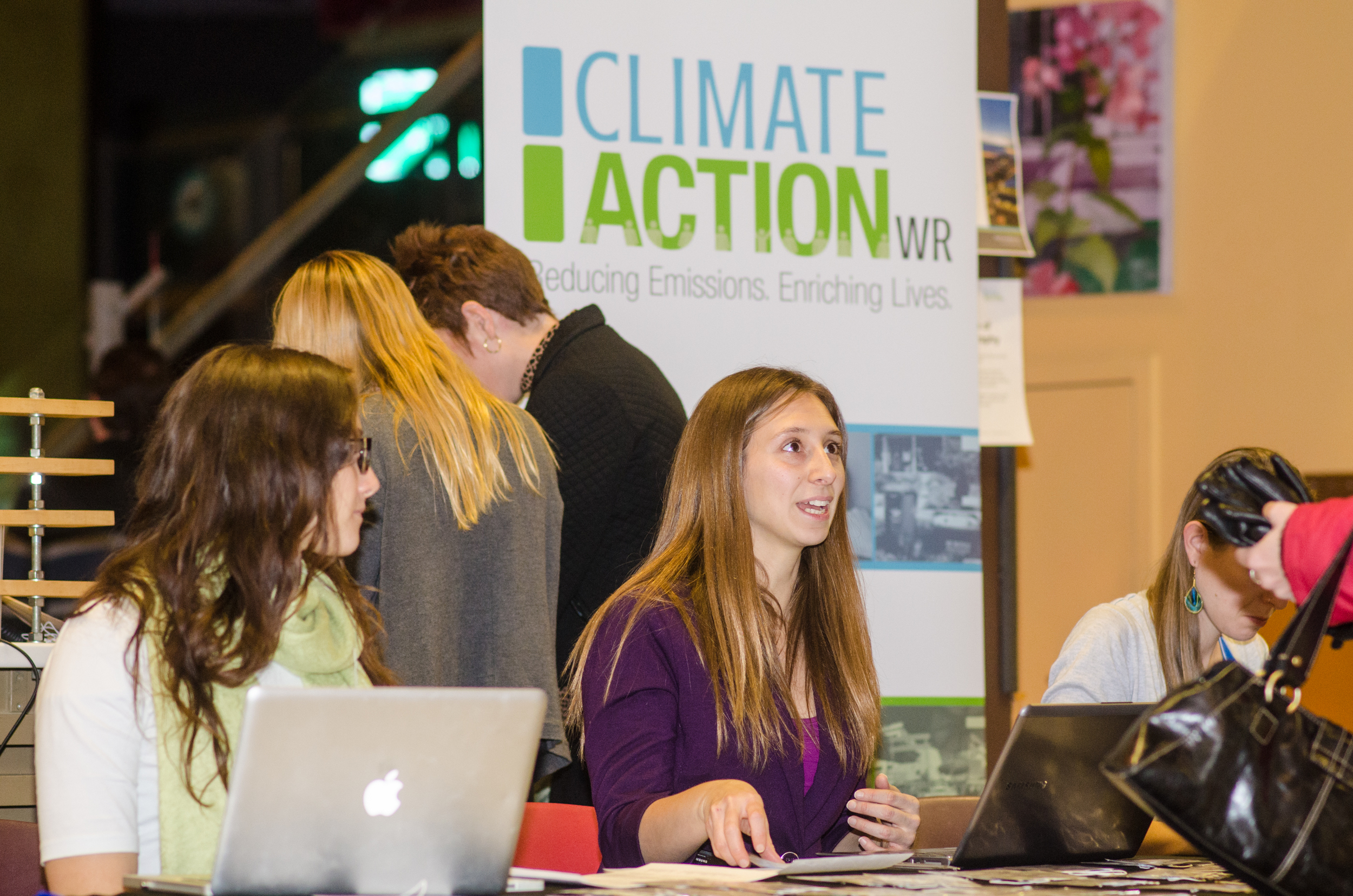 Nina Blagojevic  and  Lisa Chapman  handle registrants for ClimateActionWR's 1st Anniversary.