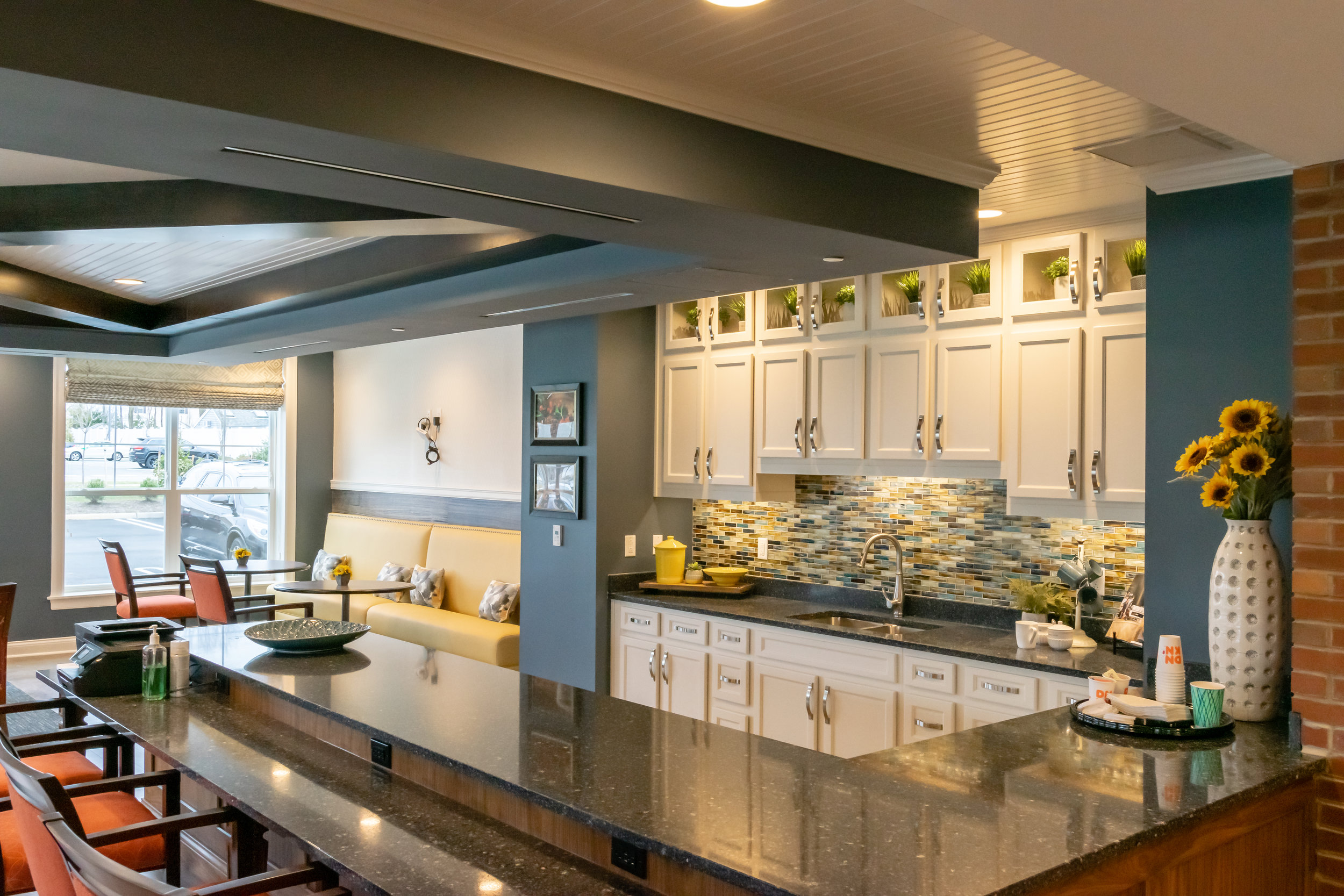 Interior Kitchen Bar The Chelsea Senior Living Facility Built by March Associates Construction. We build luxury residential buildings.