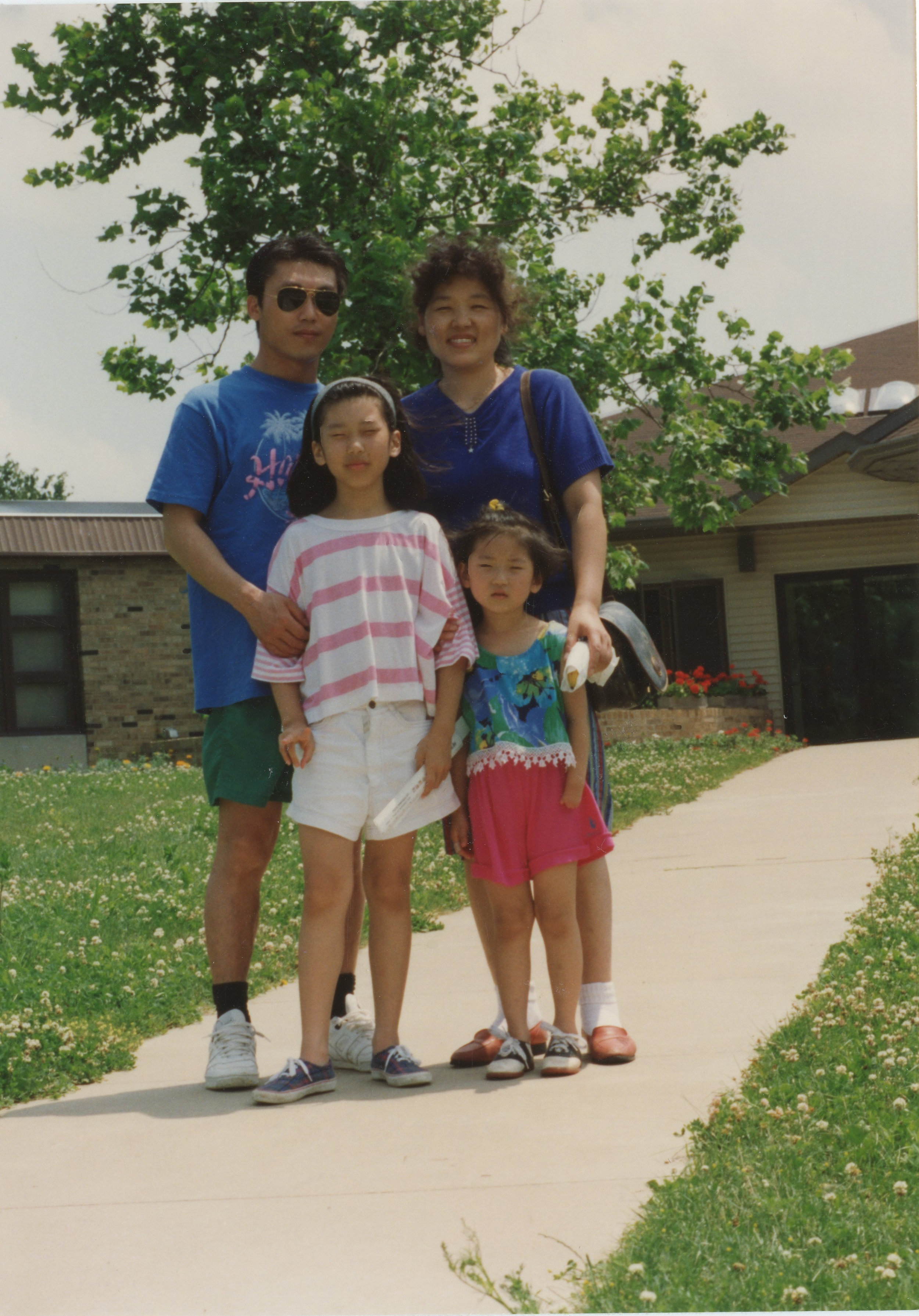 "Elise Byun and Family. "" I'm not sure of the exact year. My guess is 1991 or 1992.  I  think I'm 4 years old but my mom says 3 or 4. Don't I look too big to be 3 years old? Shrug."""