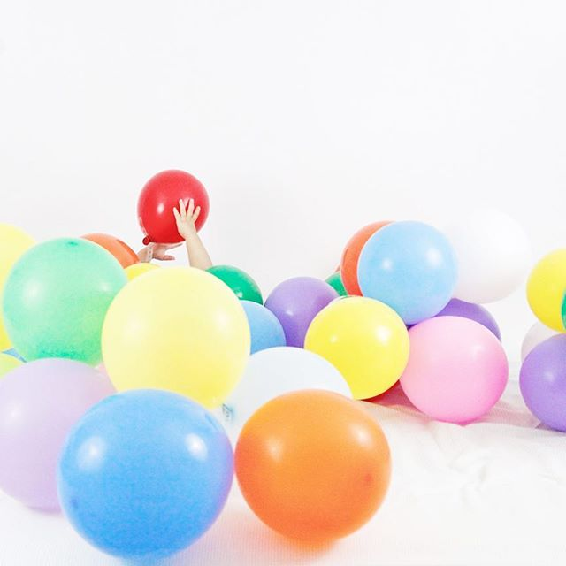 I have felt pretty buried by life since the second kid has been nonstop moving since basically two weeks old. The thought of ever getting work done again feels impossible. The house is always a mess. The laundry is never done but childhood is pretty magical. So let's stick with that chaotic beauty for right now. And yes, that's my daughter buried under balloons because hey, there's endless fun in messes.