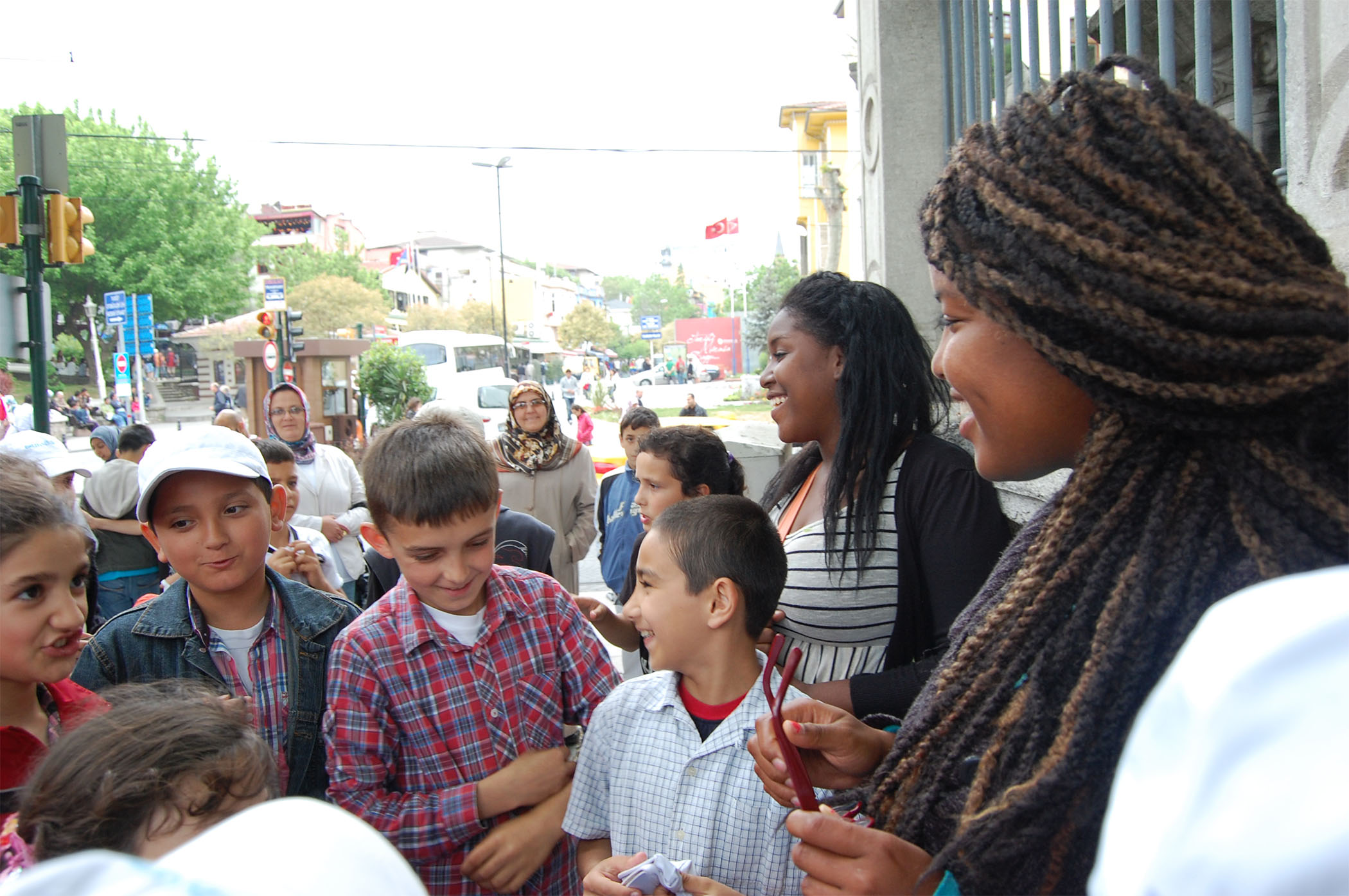 Yaminah and I in Istanbul greeting a crowd of curious kids who were fascinated by our skin and hair.