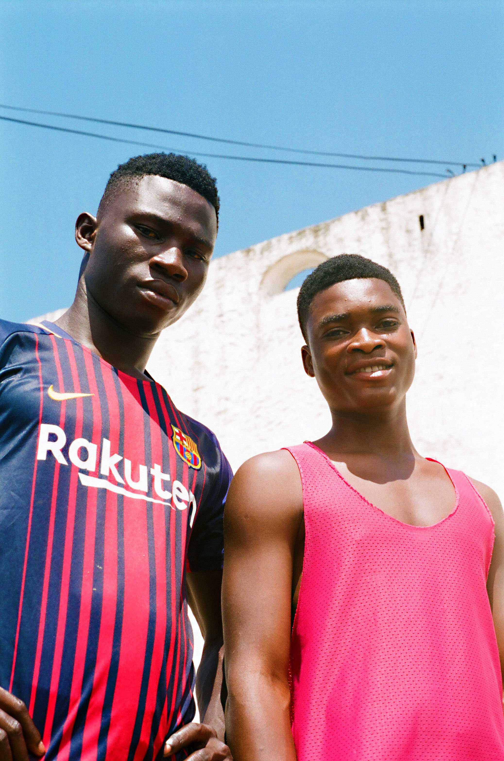 These two young men standing outside the castle are a reminder of the future Ghana