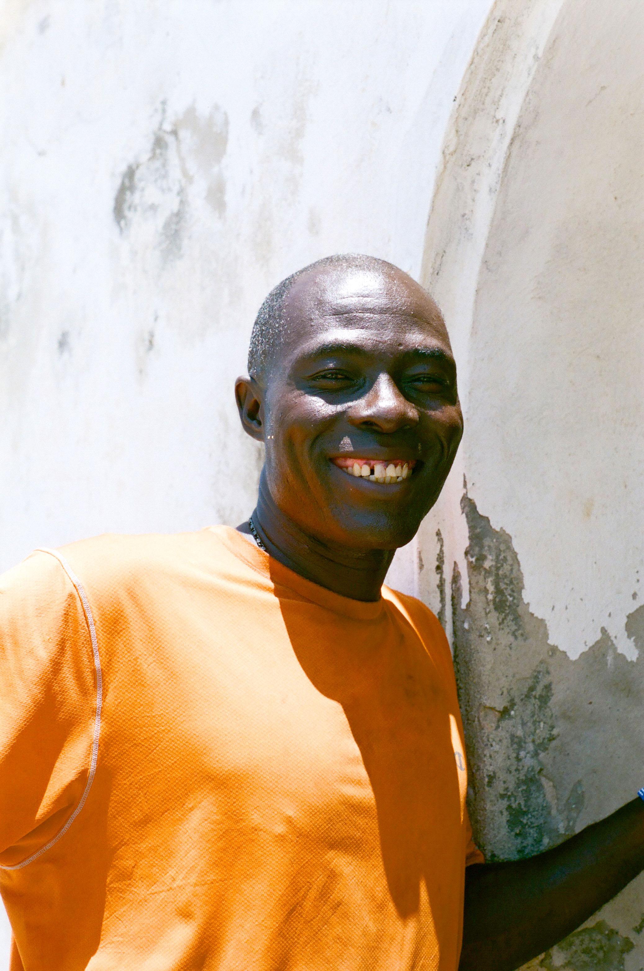 Papa niche posing near his post at Elmina Castle.