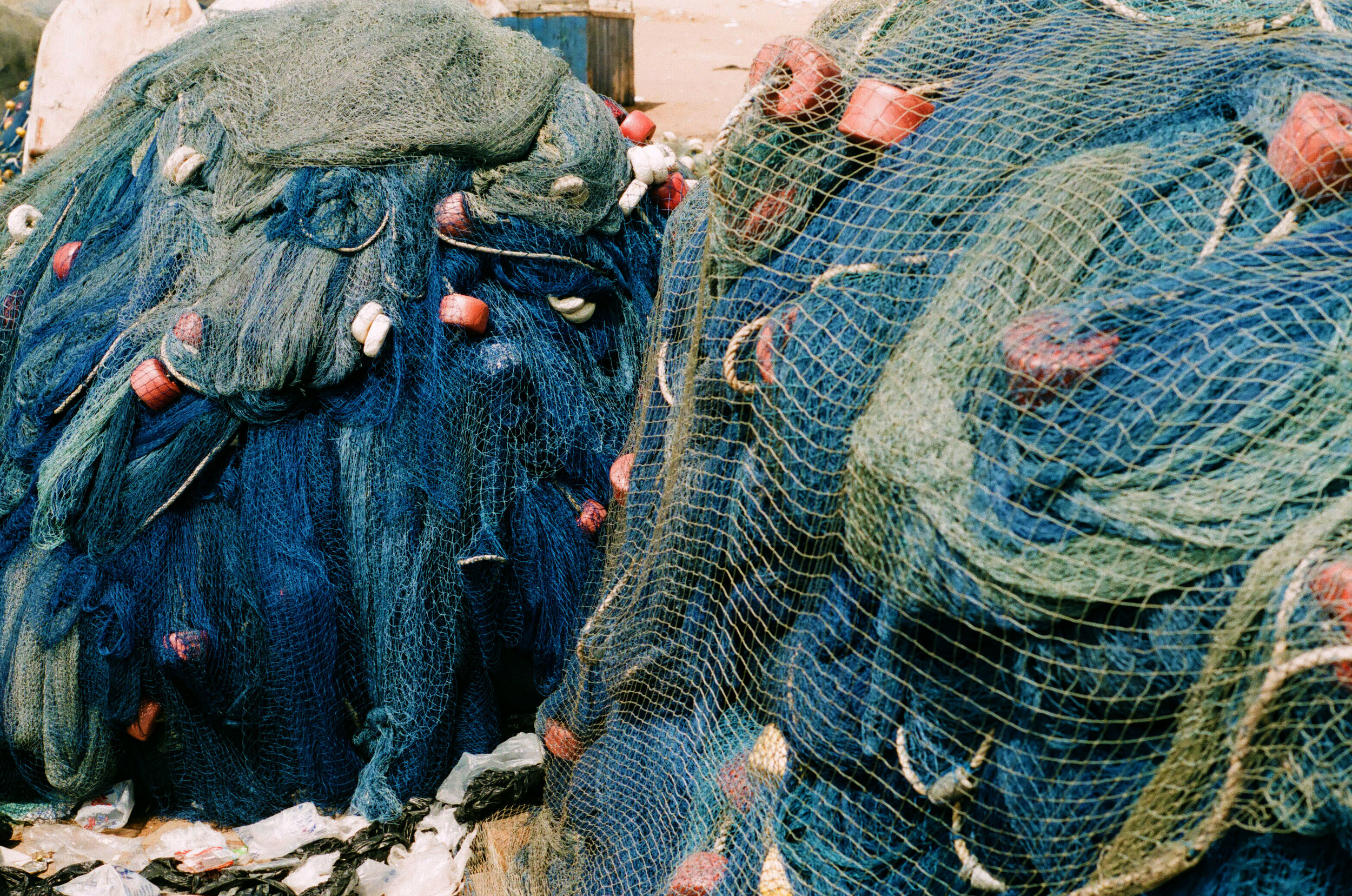 Nets used by fishermen adorn the lower levels of Elmina Castle.