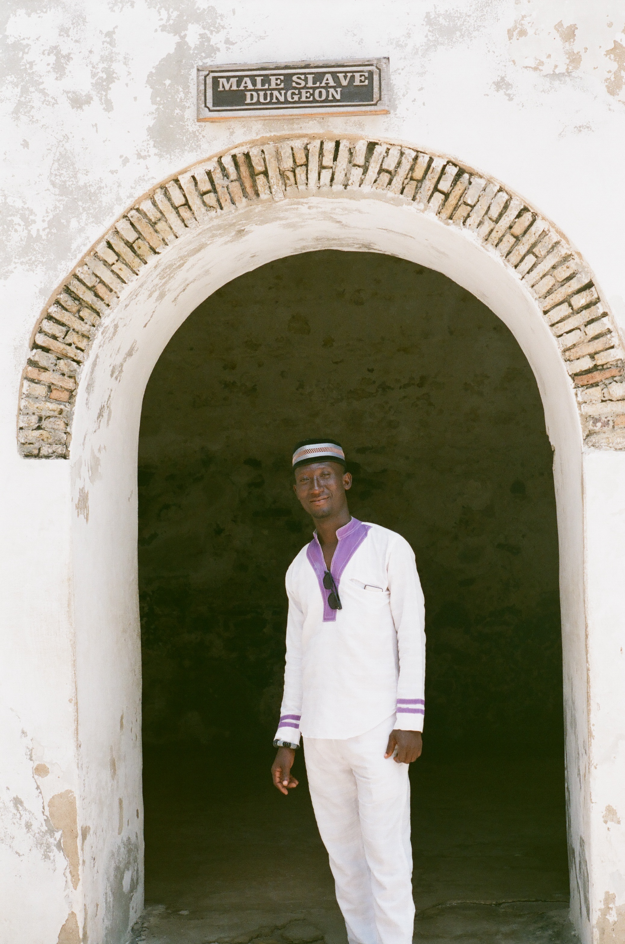 This image of a castle guide standing in front of the entrance to male slave dungeons is a testament to miracle of survival.