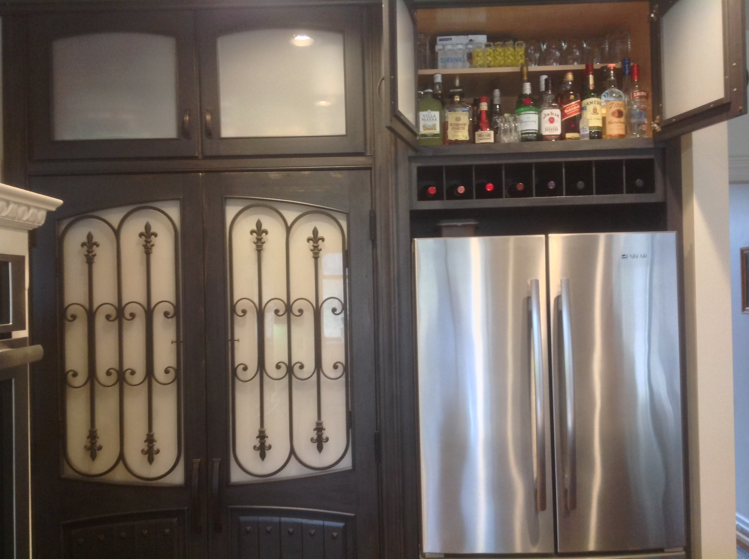 custom made bar and wine rack above refrigerator