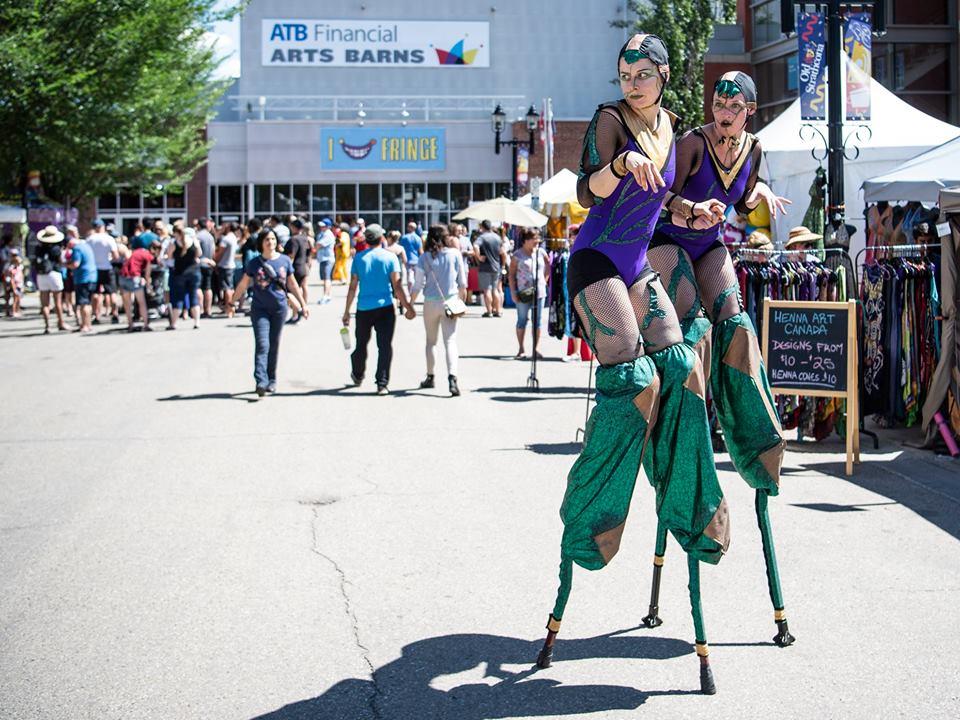 Acro Aliens - Edmonton International Street Performer's Festival. Photo by Marc Chalifoux