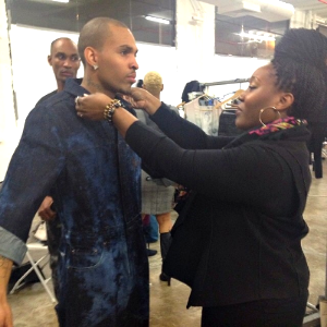Adding the last minute touches on the model before hitting the runway at Brooklyn Fashion Week