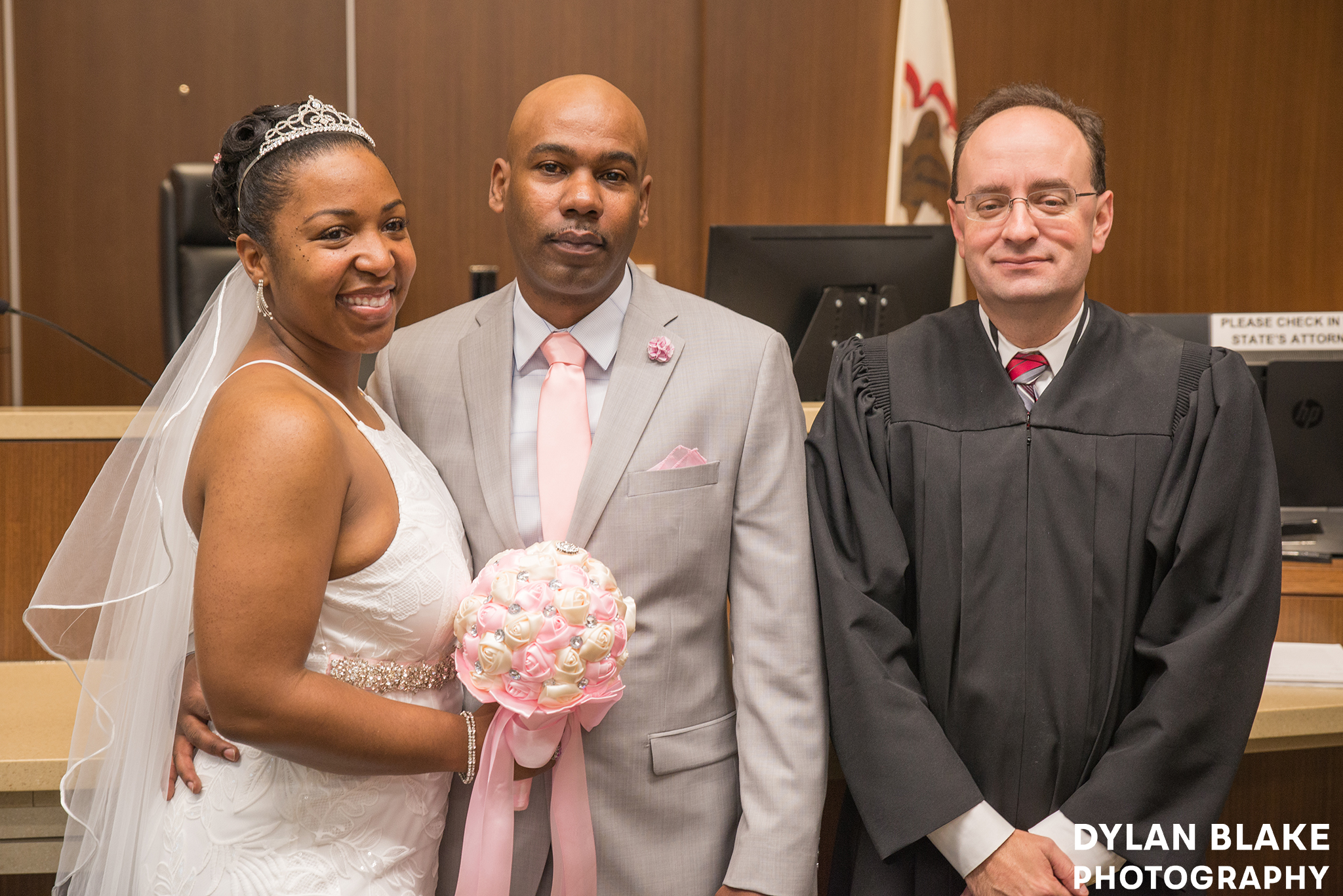 4-lake-county-il-courthouse-wedding-courtroom-couple-portrait-with-judge-01.jpg