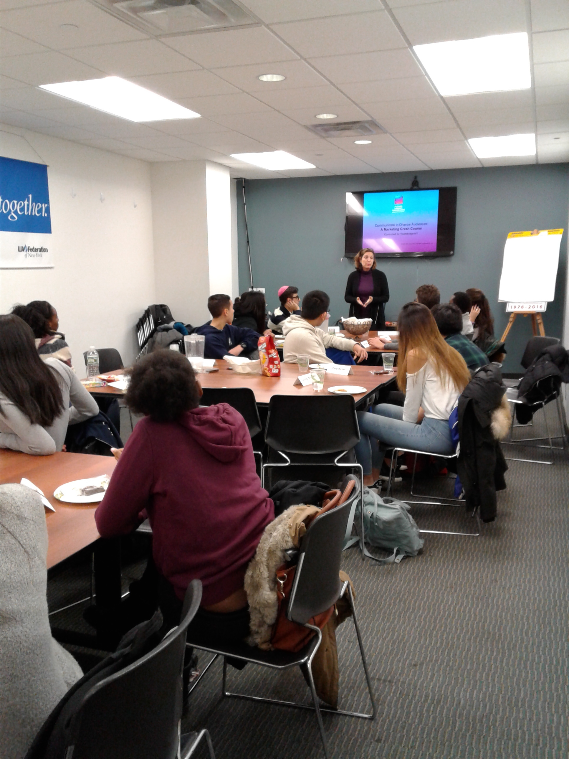 Fellows get a crash course in the world of marketing and communications with YouthBridge-NY Board Member Ivy Cohen.