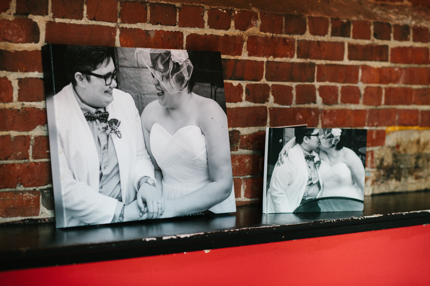 As soon as I walked in, I could see where they had all my images from their ceremony! They had printed and matted one of the pictures that they set right by the entryway, so that all of their guests could sign the matte. They even had a projector showing a slideshow of a bunch of the pictures! So cool!