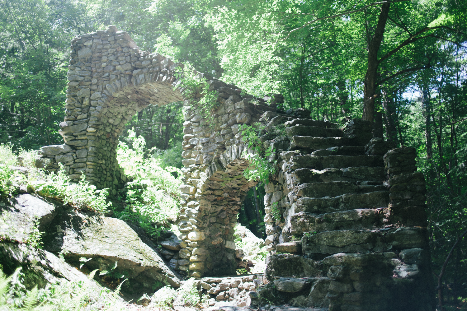 Madame Sherrie's Castle in Chesterfield, NH still has a stone staircase left! There is also a cement foundation and caved in basement behind it.