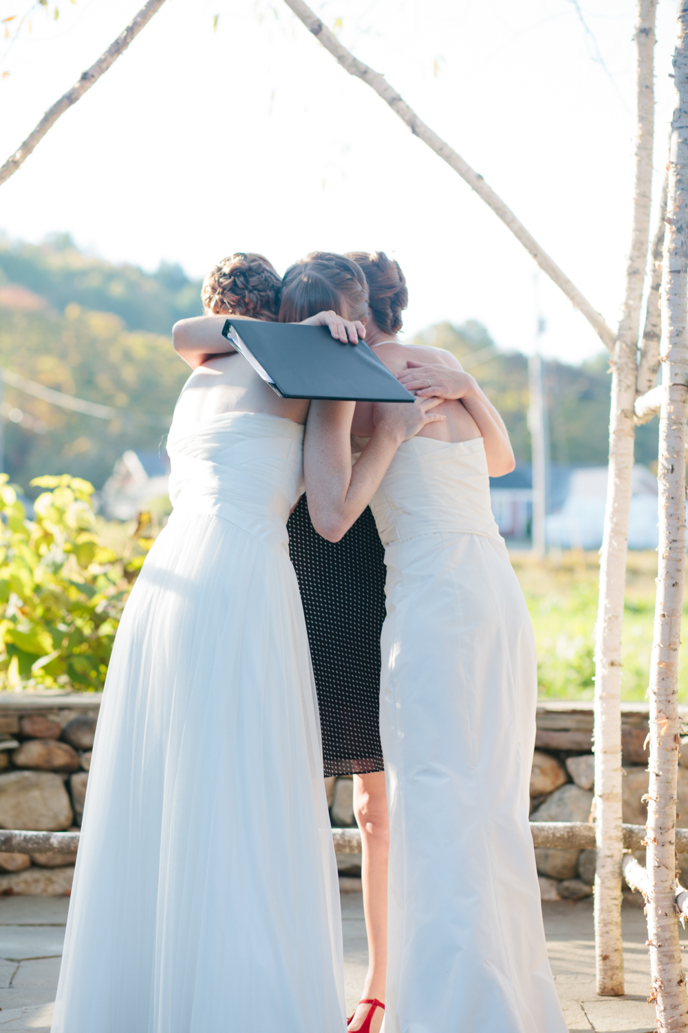 And a hug with their officiant/great friend.