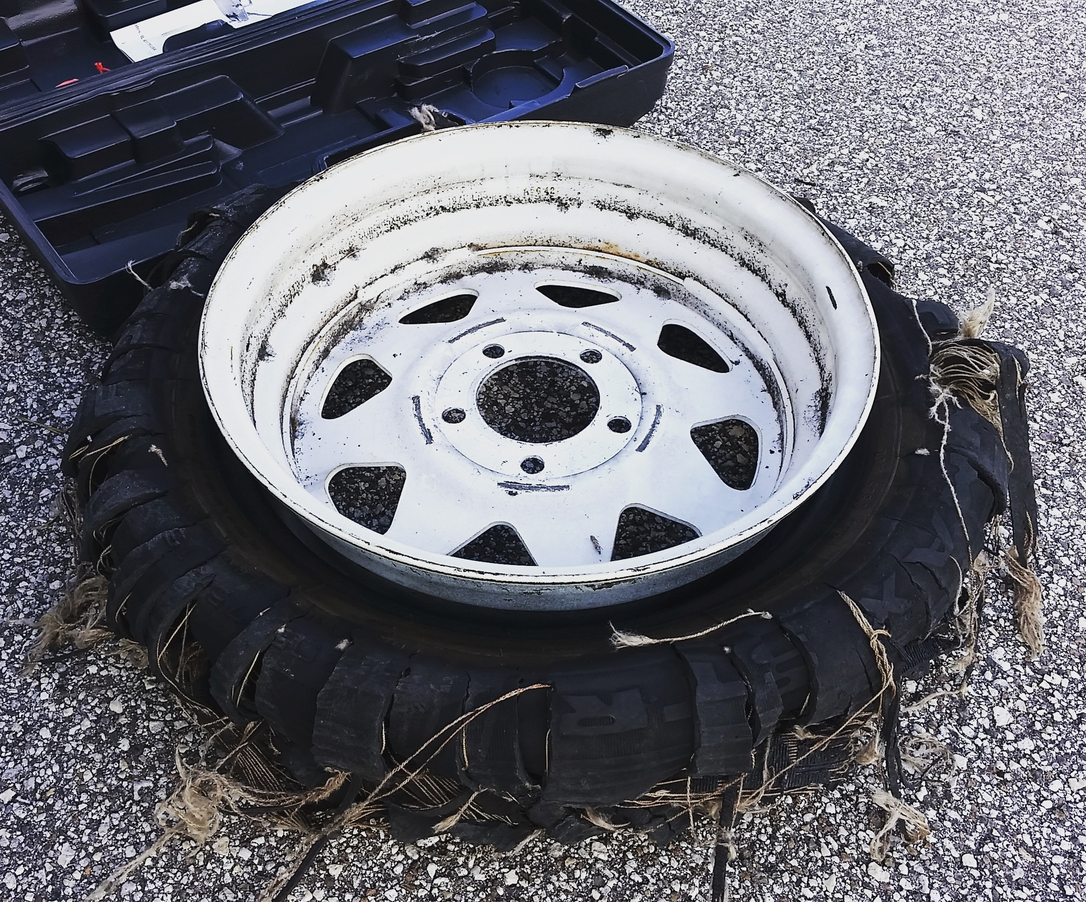 The blown tire, in all its shredded and mangled glory...