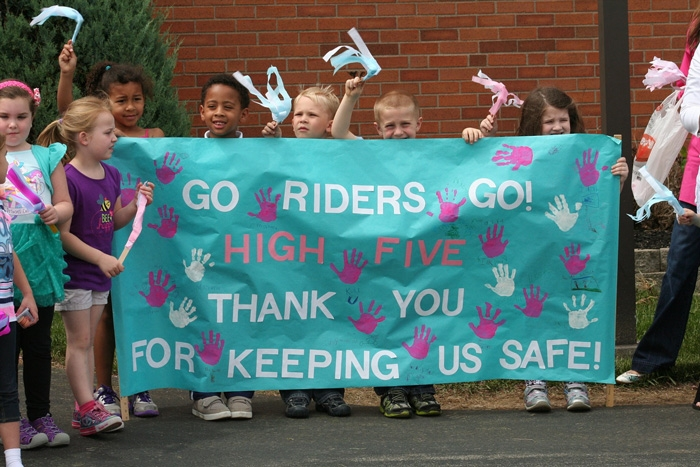 Children cheer on our riders!
